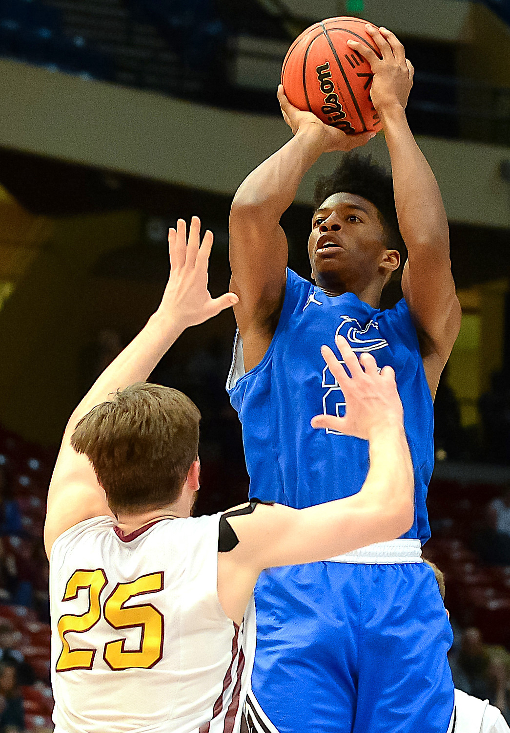 Cordova's Isaac Chatman shoots over a Madison Academy defender during the Class 4A championship game in Birmingham in March. The Blue Devils won the county's first AHSAA basketball title.
