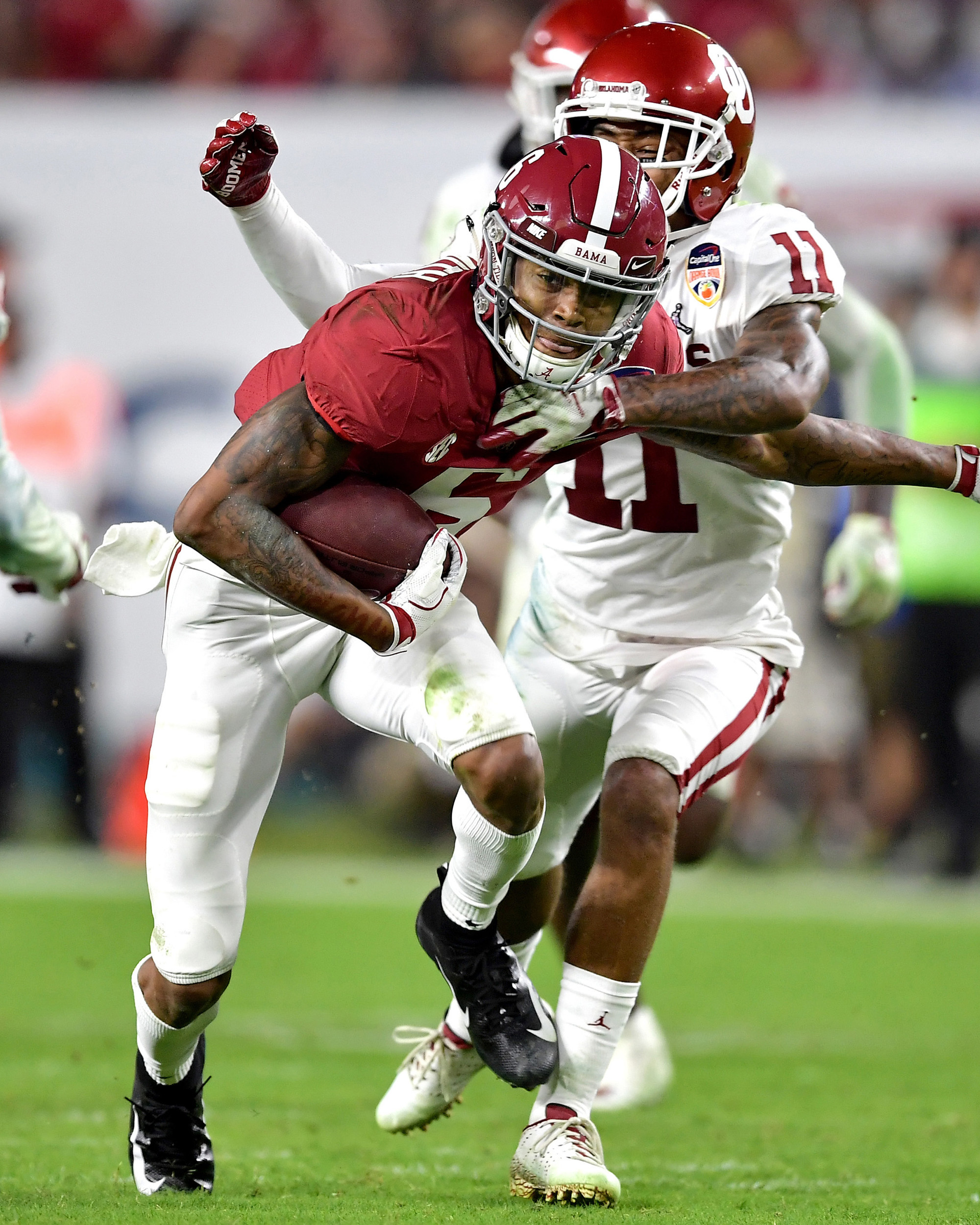Alabama Crimson Tide wide receiver DeVonta Smith (6) looks to add yards after the reception in the second half of the Capital One Orange Bowl, featuring Alabama and the Oklahoma Sooners, at Hard Rock Stadium in Miami Gardens, Fla., Saturday, Dec. 29, 2018. Alabama wins 45-34. (Photo by Lee Walls)