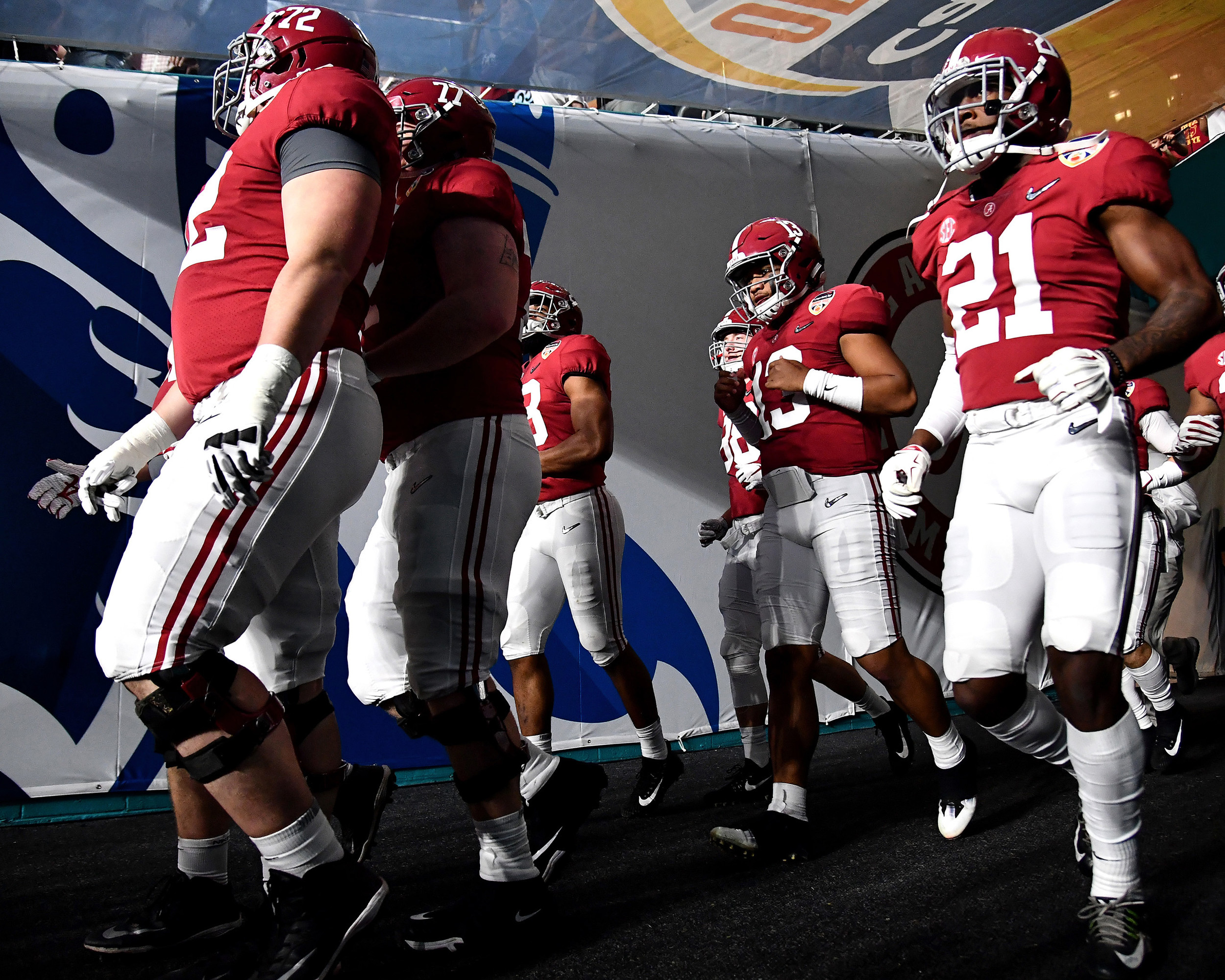 Alabama Crimson Tide quarterback Tua Tagovailoa (13), along with his teammates, exits the tunnel prior to the start of the Capital One Orange Bowl, featuring Alabama and the Oklahoma Sooners, at Hard Rock Stadium in Miami Gardens, Fla., Saturday, Dec. 29, 2018. Alabama wins 45-34. (Photo by Lee Walls)