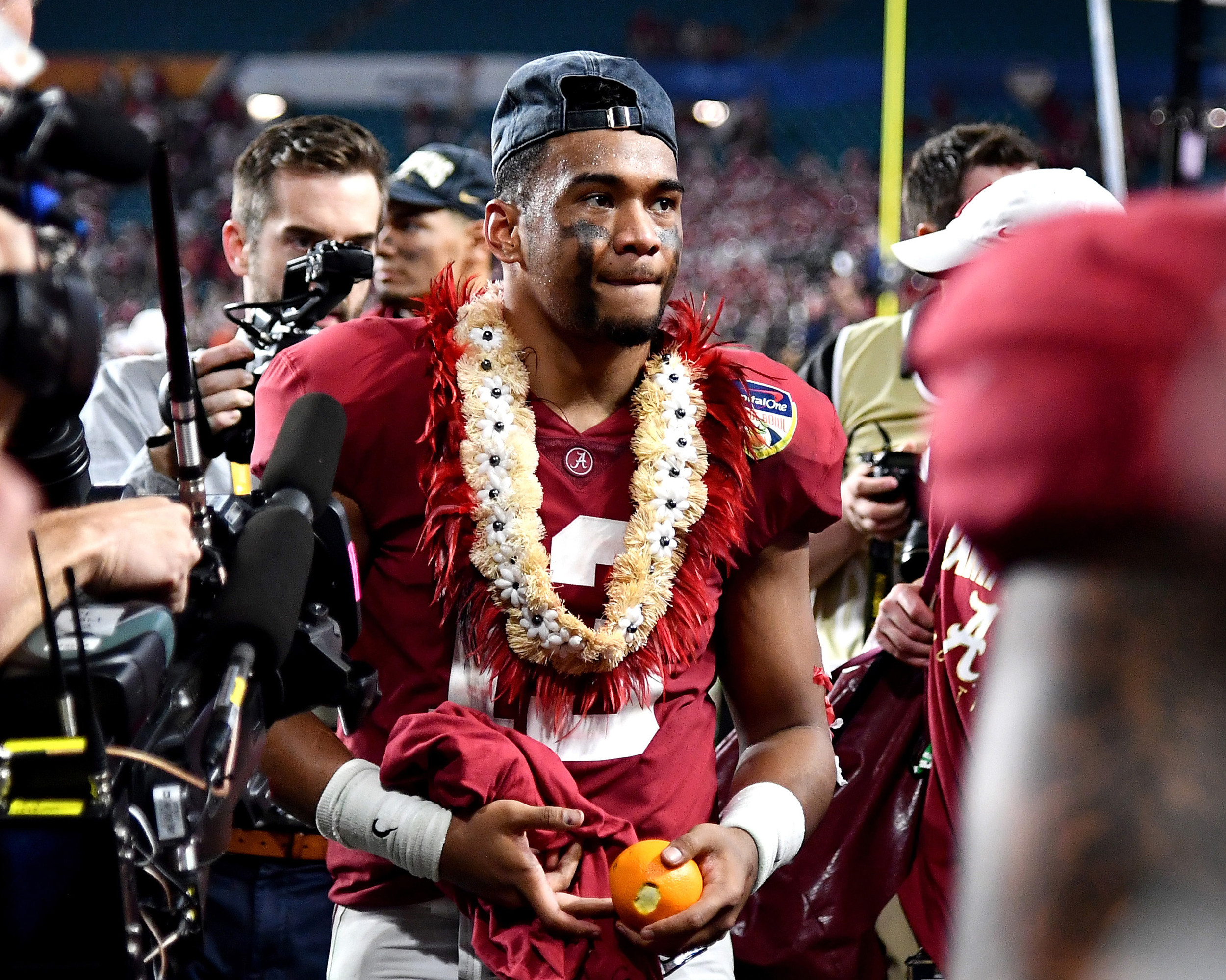 Alabama Crimson Tide quarterback Tua Tagovailoa (13) leaves the stadium following the Capital One Orange Bowl at Hard Rock Stadium in Miami Gardens, Fla., Saturday, Dec. 29, 2018. Alabama wins 45-34. (Photo by Lee Walls)