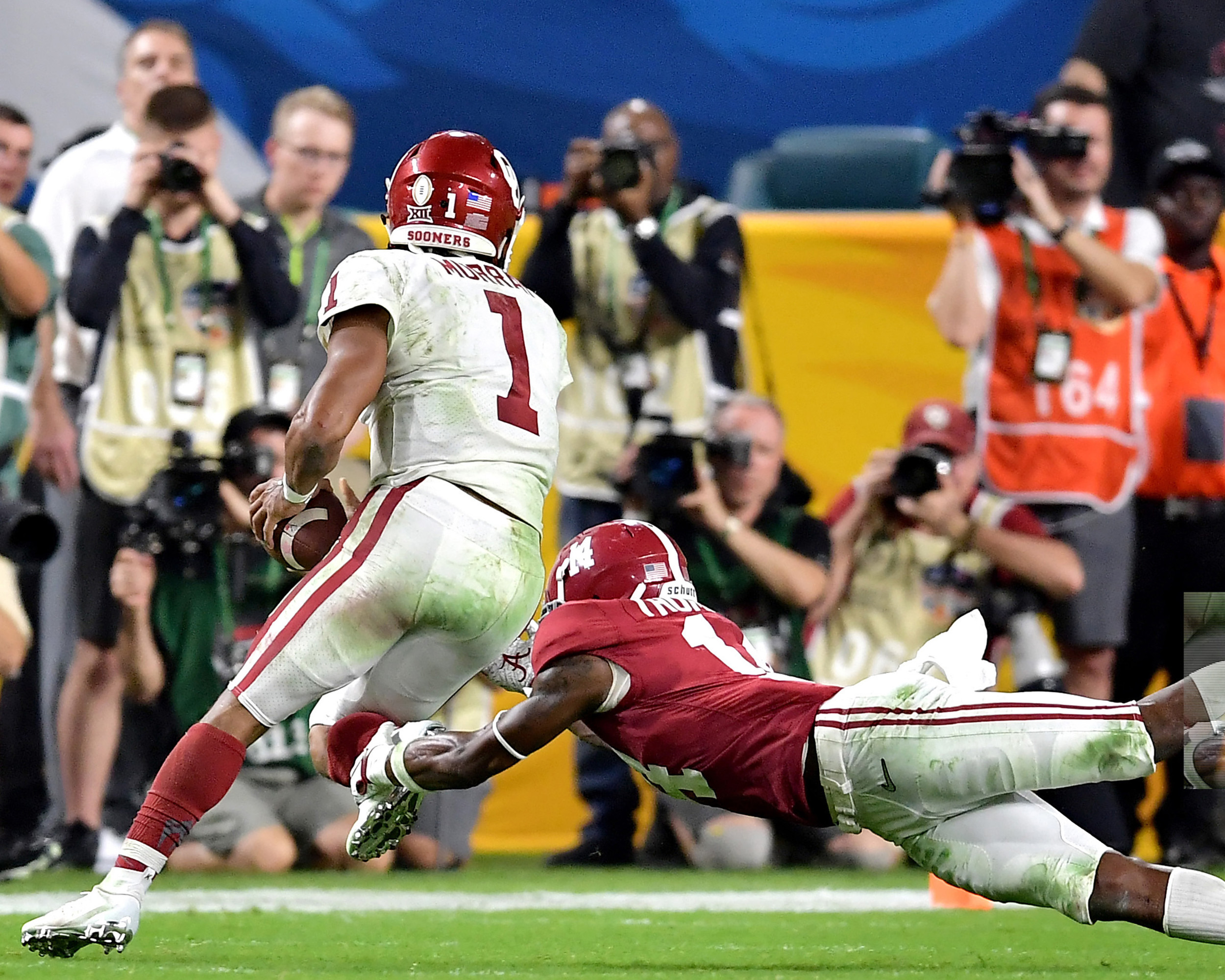 Alabama Crimson Tide defensive back Deionte Thompson (14) gets the shoestrings of Oklahoma Sooners quarterback Kyler Murray (1) during the second half of the Capital One Orange Bowl at Hard Rock Stadium in Miami Gardens, Fla., Saturday, Dec. 29, 2018. Alabama wins 45-34. (Photo by Lee Walls)