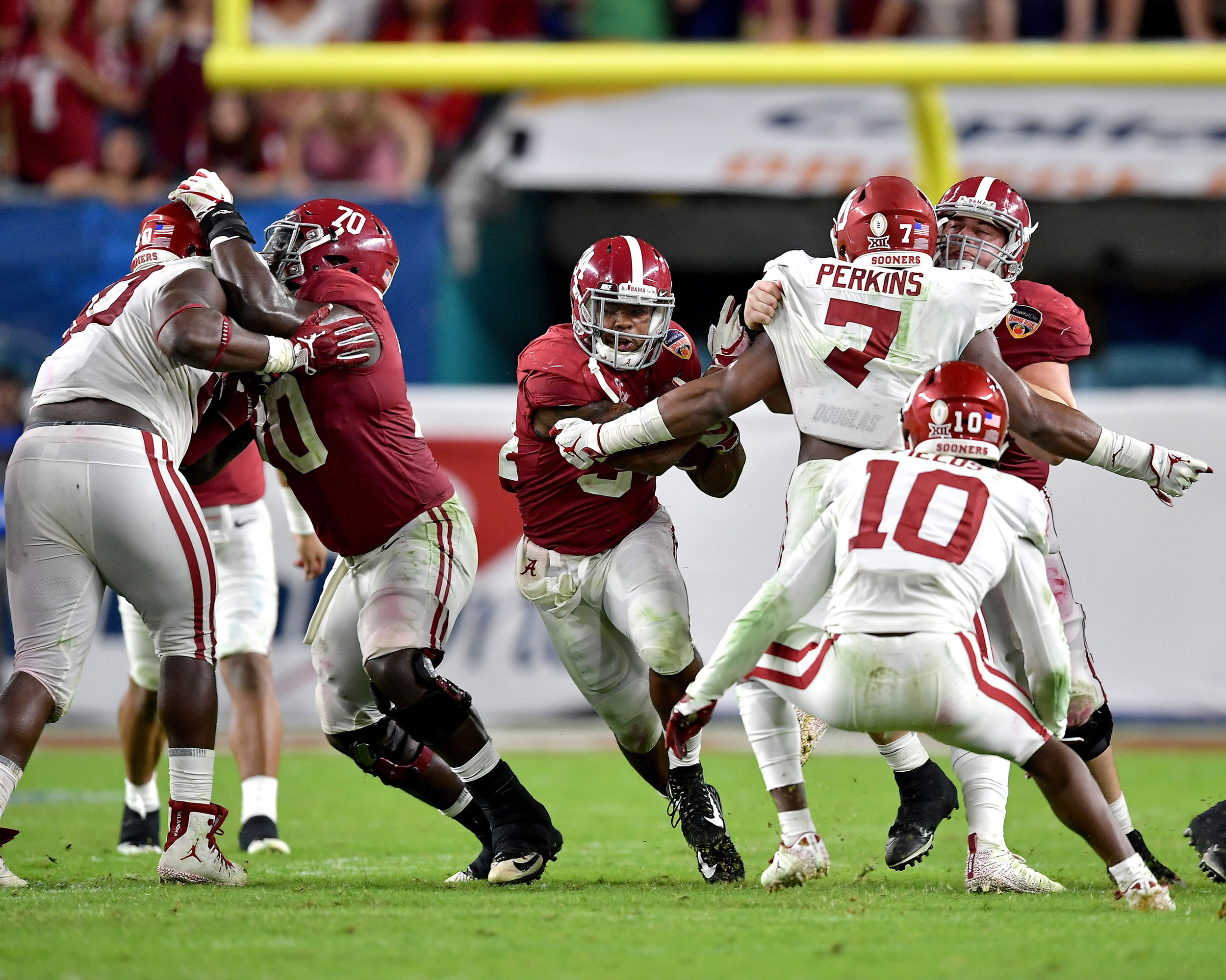 Alabama Crimson Tide running back Damien Harris (34) with a carry up the middle in the second half of the Capital One Orange Bowl, featuring Alabama Crimson Tide and the Oklahoma Sooners, at Hard Rock Stadium in Miami Gardens, Fla., Saturday, Dec. 29, 2018. Alabama wins 45-34. (Photo by Lee Walls)