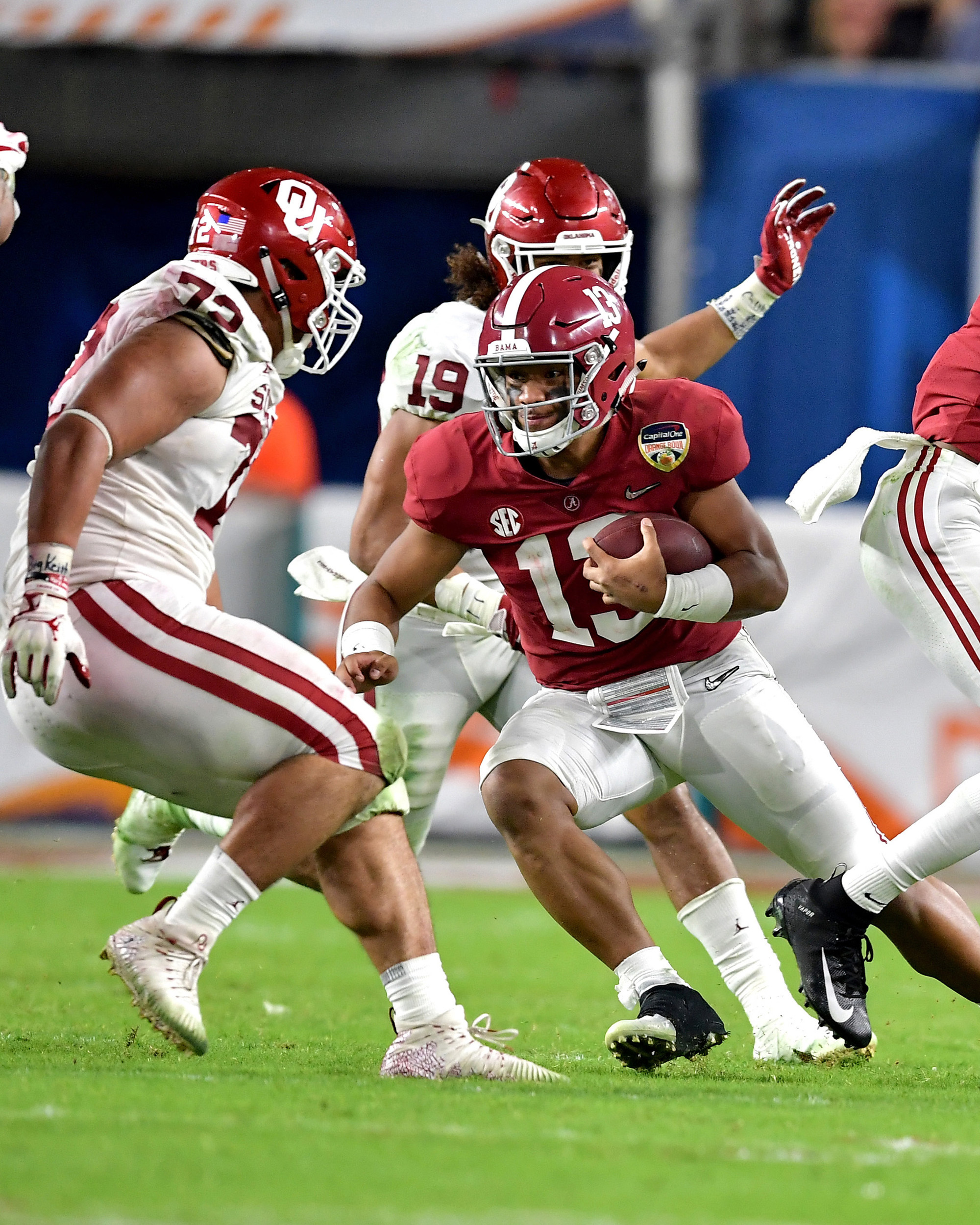 Alabama Crimson Tide quarterback Tua Tagovailoa (13) with a keeper during the second half of the Capital One Orange Bowl, featuring Alabama and the Oklahoma Sooners, at Hard Rock Stadium in Miami Gardens, Fla., Saturday, Dec. 29, 2018. Alabama wins 45-34. (Photo by Lee Walls)