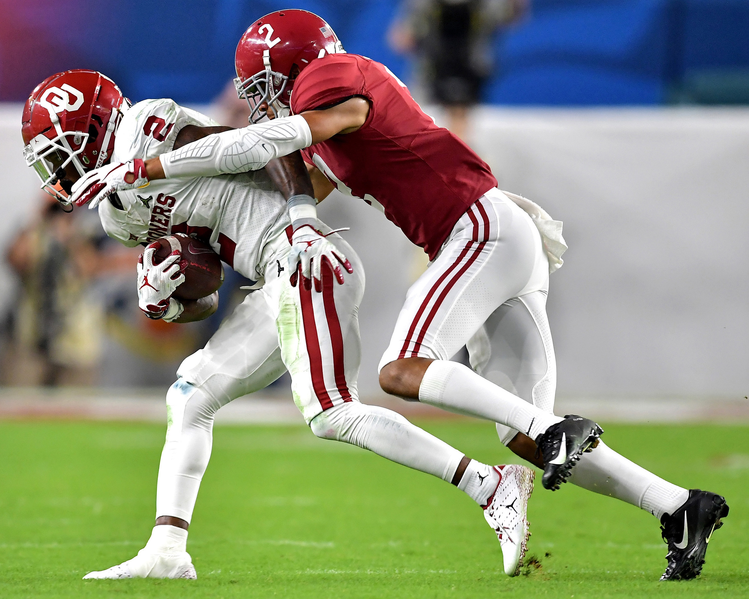 Oklahoma Sooners wide receiver CeeDee Lamb (2) is tackled by Alabama Crimson Tide defensive back Patrick Surtain II (2) during the second half of the Capital One Orange Bowl at Hard Rock Stadium in Miami Gardens, Fla., Saturday, Dec. 29, 2018. Alabama wins 45-34. (Photo by Lee Walls)