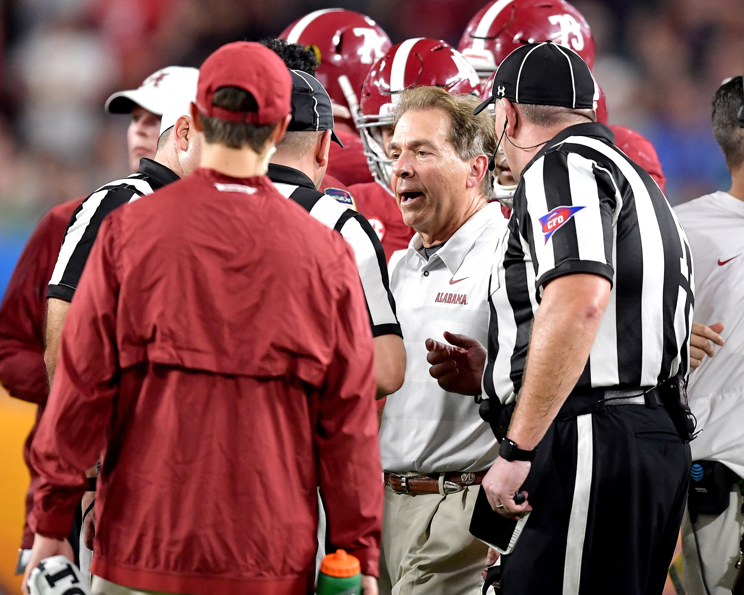 Alabama Crimson Tide head coach Nick Saban discusses a call with officials during the first half of the Capital One Orange Bowl, featuring Alabama and the Oklahoma Sooners, at Hard Rock Stadium in Miami Gardens, Fla., Saturday, Dec. 29, 2018. Alabama wins 45-34. (Photo by Lee Walls)