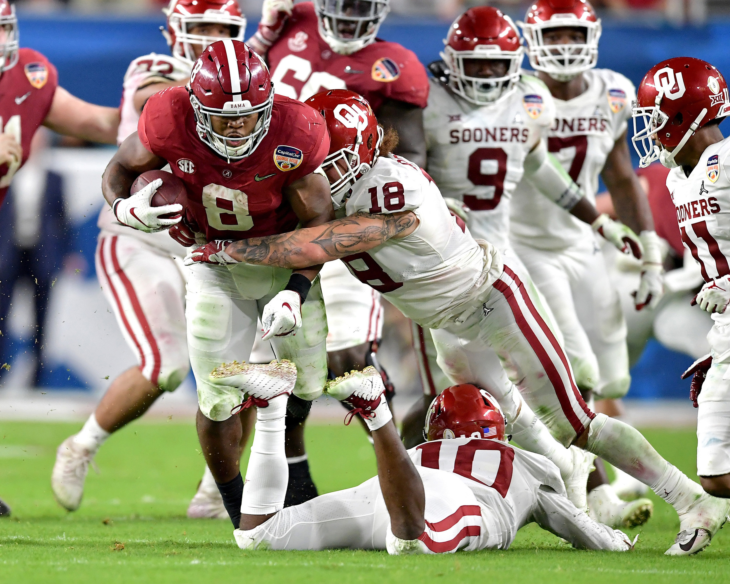Alabama Crimson Tide running back Josh Jacobs (8) with a carry in the first half of the Capital One Orange Bowl, featuring Alabama and the Oklahoma Sooners, at Hard Rock Stadium in Miami Gardens, Fla., Saturday, Dec. 29, 2018. Alabama wins 45-34. (Photo by Lee Walls)
