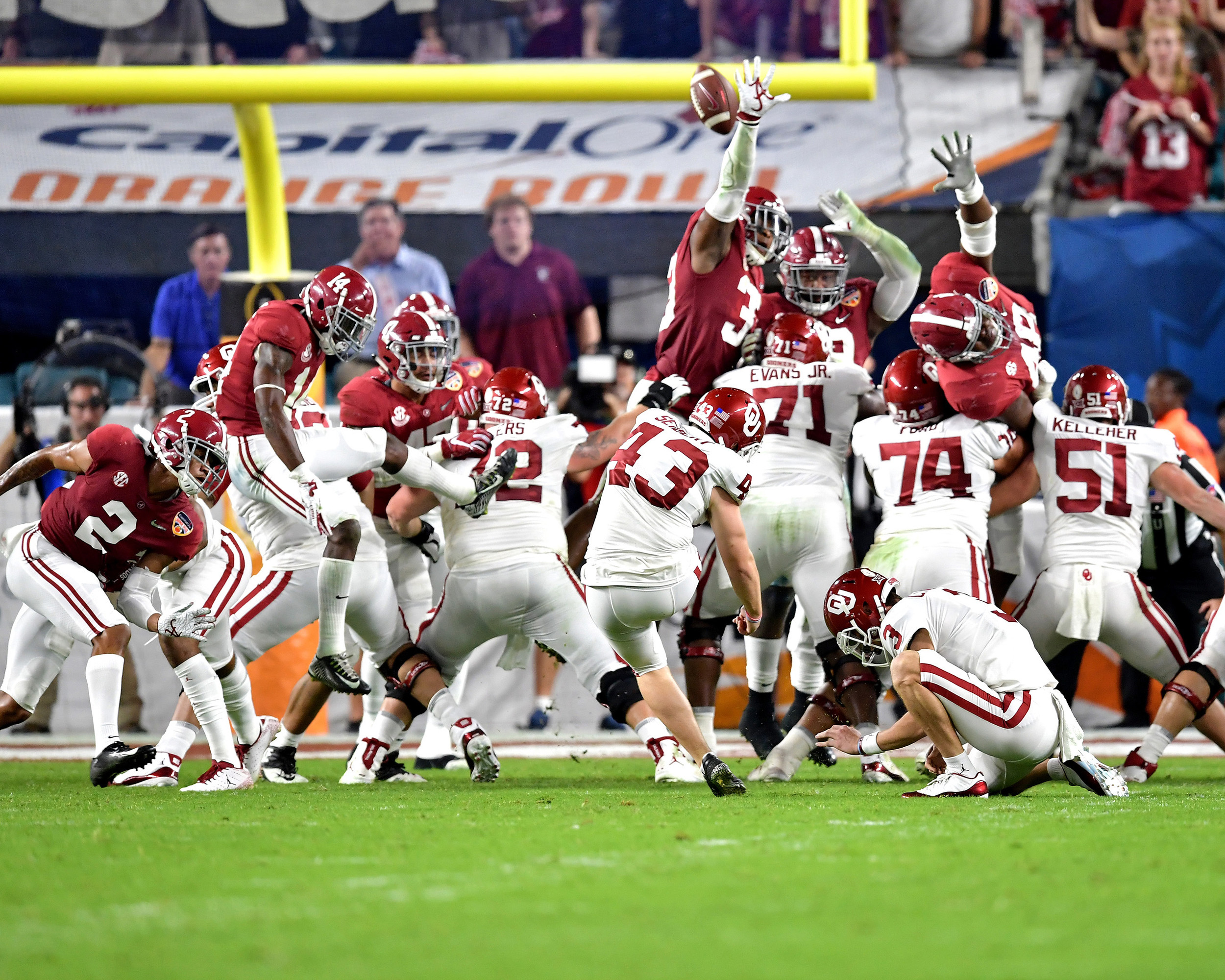 Alabama tries to block a kick during the first half of the Capital One Orange Bowl, featuring Alabama and the Oklahoma Sooners, at Hard Rock Stadium in Miami Gardens, Fla., Saturday, Dec. 29, 2018. Alabama wins 45-34. (Photo by Lee Walls)