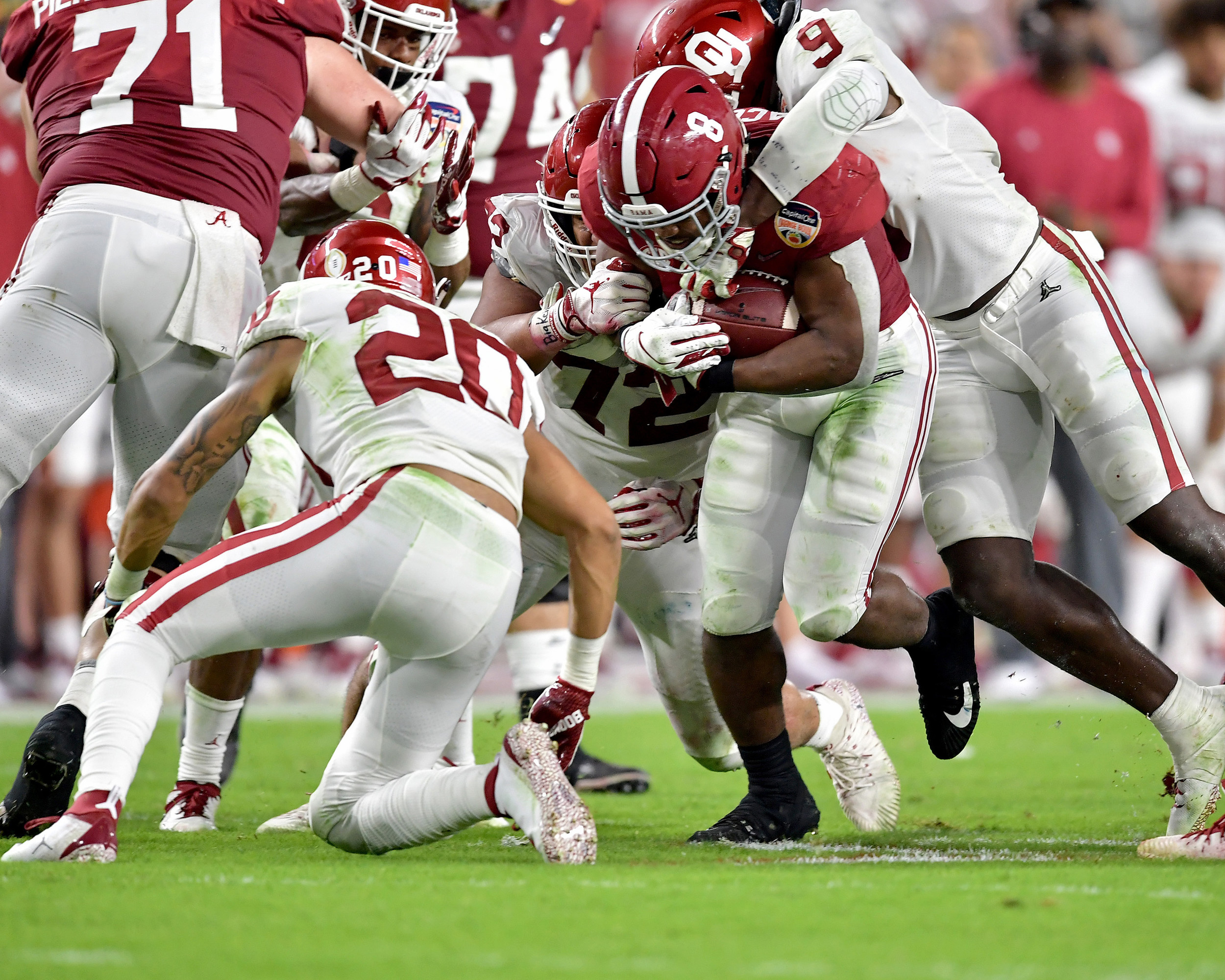 Alabama Crimson Tide running back Josh Jacobs (8) powers up the middle during the first half of the Capital One Orange Bowl, featuring Alabama and the Oklahoma Sooners, at Hard Rock Stadium in Miami Gardens, Fla., Saturday, Dec. 29, 2018. Alabama wins 45-34. (Photo by Lee Walls)