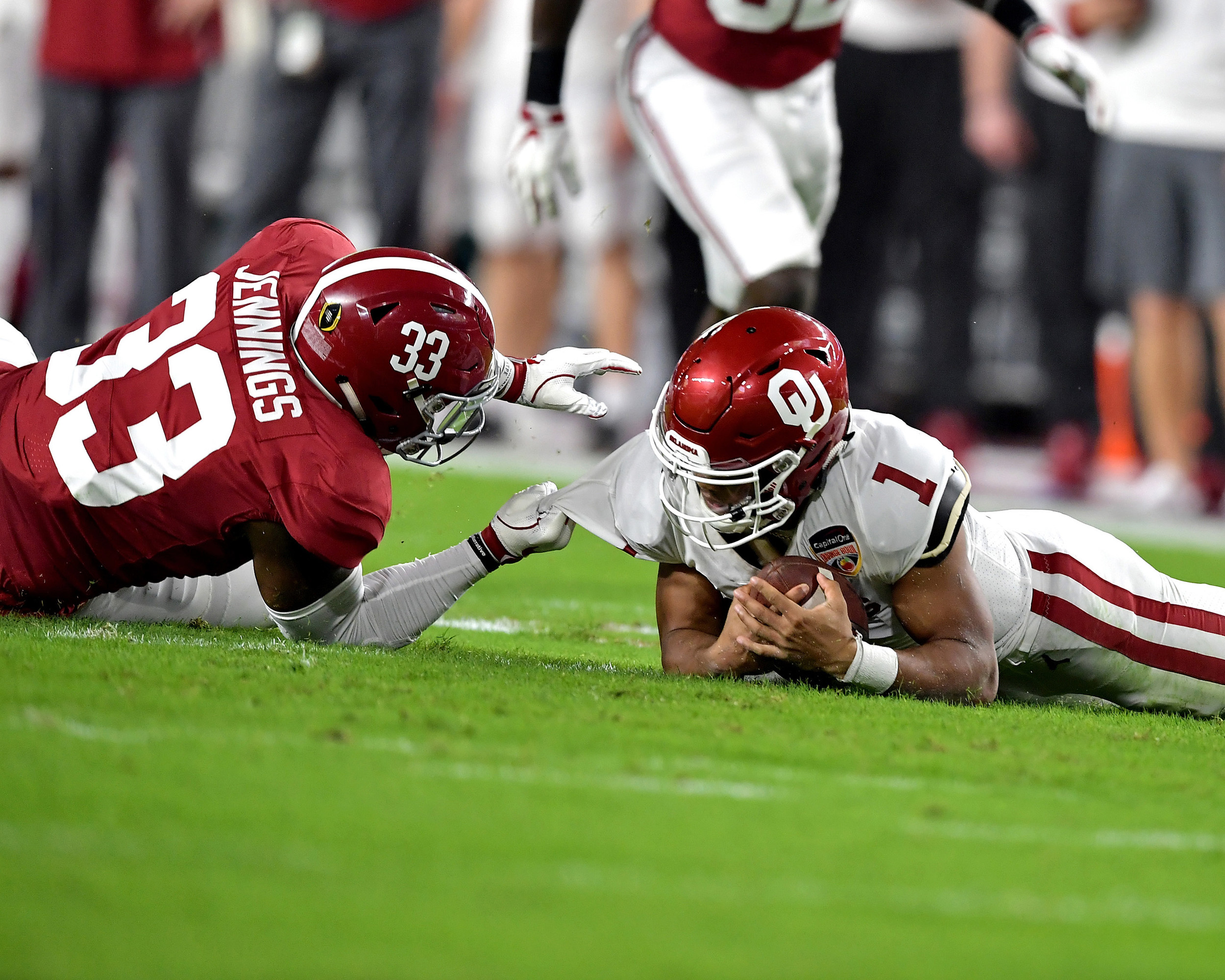 Alabama Crimson Tide linebacker Anfernee Jennings (33) sacks Oklahoma Sooners quarterback Kyler Murray in the first quarter of the Capital One Orange Bowl at Hard Rock Stadium in Miami Gardens, Fla., Saturday, Dec. 29, 2018. Alabama wins 45-34. (Photo by Lee Walls)