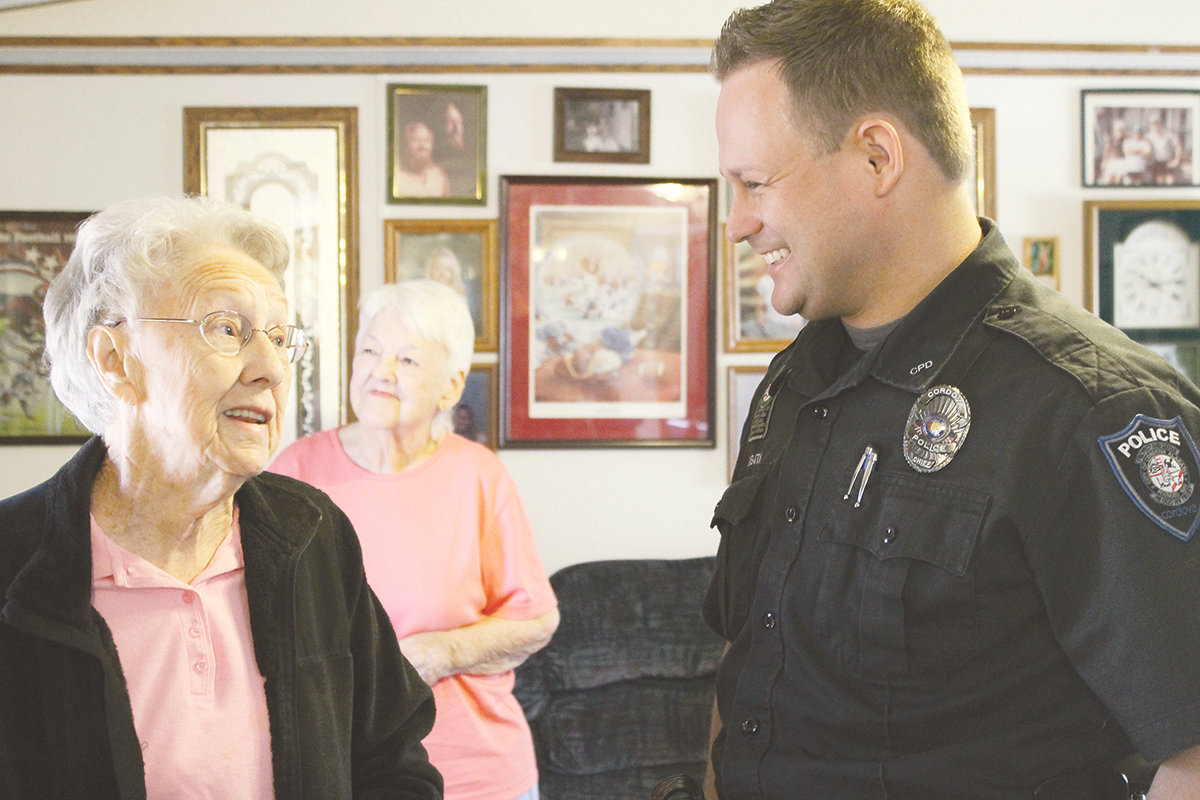 Cordova Police Chief Nick Smith celebrates the one-year anniversary of the Good Morning program in 2014 with resident Lucille Wise, who became a surrogate grandmother to Smith during his tenure in Cordova.