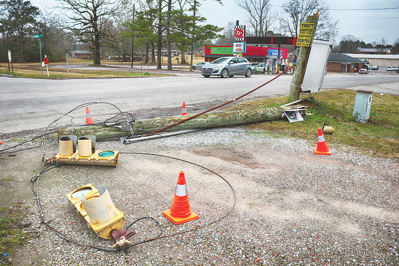 The City of Sumiton workers turned the intersection of Main Street and Empire Road into a three-way-stop after a New Year's Eve accident that knocked down a pole holding the lights and control box.