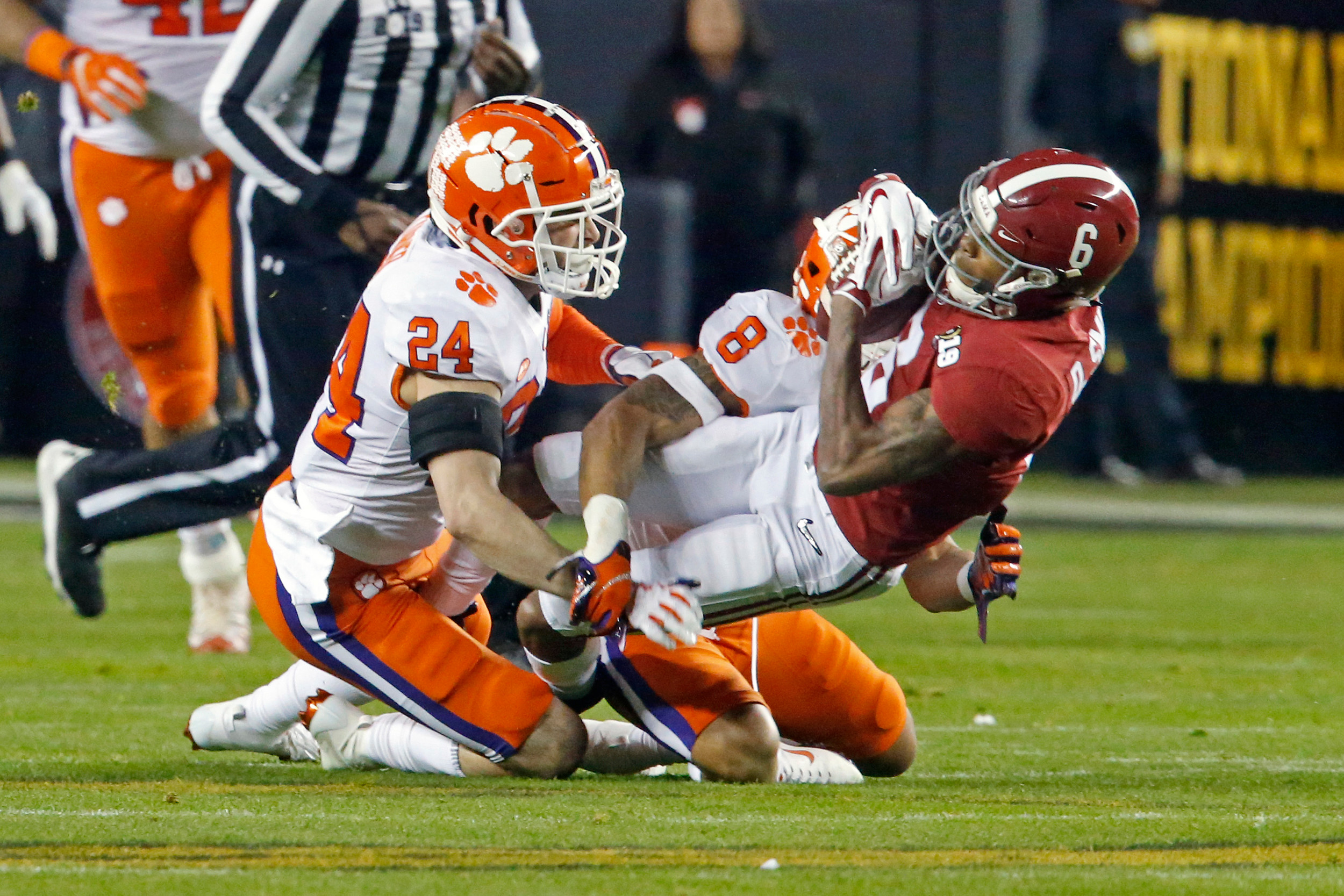Clemson safety Nolan Turner (24) puts a hard hit on Alabama wide receiver DeVonte Smith (6) during the NCAA college football national championship game between Clemson University and the University of Alabama in Santa Clara, CA. Credit: Jason Clark / Daily Mountain Eagle