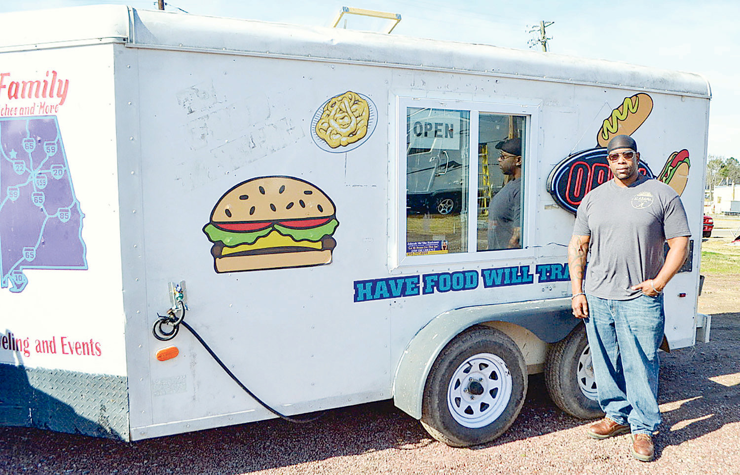 Freddy Poe stands outside his food truck in Jasper Monday.