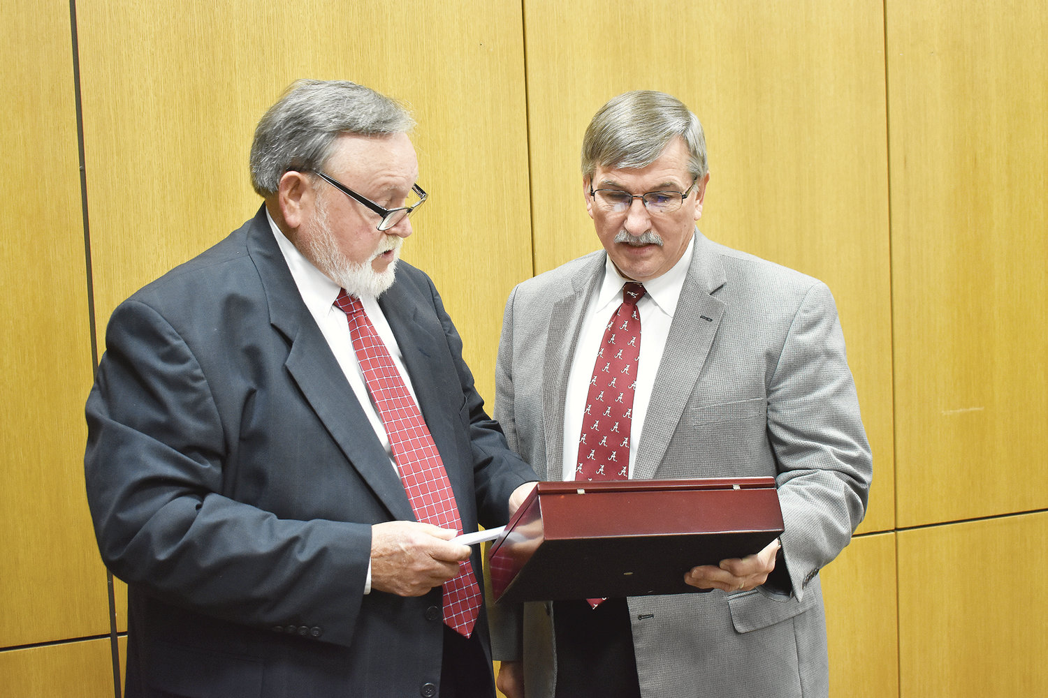 At Monday's Walker County Commission meeting, Chairman Jerry Bishop presented a ceremonial gavel to retiring Probate Judge Rick Allison in recognition of his 24 years of service in that position. Allison showed off the gavel to other commissioners, who all congratulated him for his service, and received a standing ovation at the meeting after giving some brief remarks. A. Lee Tucker will be sworn in by Allison as the new probate judge on the front steps of the Walker County Courthouse on Monday, Jan. 14, at noon, with Circuit Judge Hoyt Elliott's courtroom serving as a rain location.