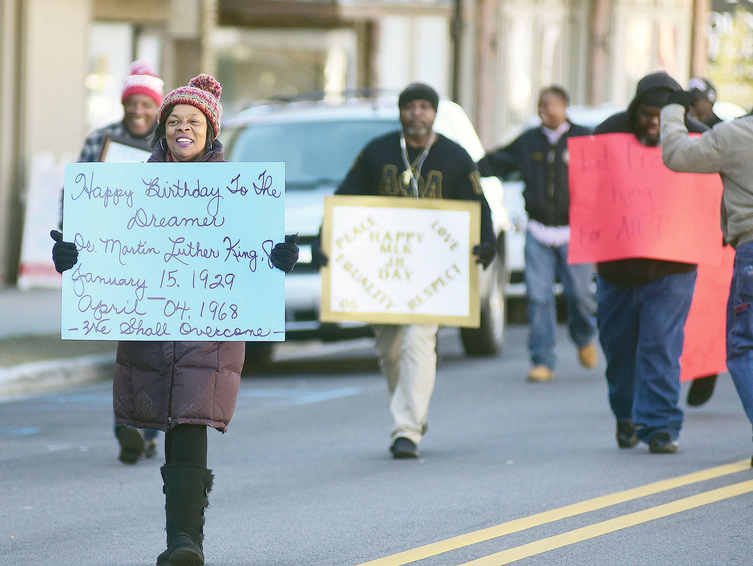 Cold temperatures led to a smaller than normal crowd for Monday's march through downtown Jasper to honor the late Dr. Martin Luther King Jr. The march, which began at A.P. Howell Park and ended at the Percy Goode Community Center, included a brief stop on the downtown square, where event participants joined in a prayer for the memory of King and what his work meant to the civil rights movement in the United States. A program was held at the Percy Goode Community Center following the march and included all ages.