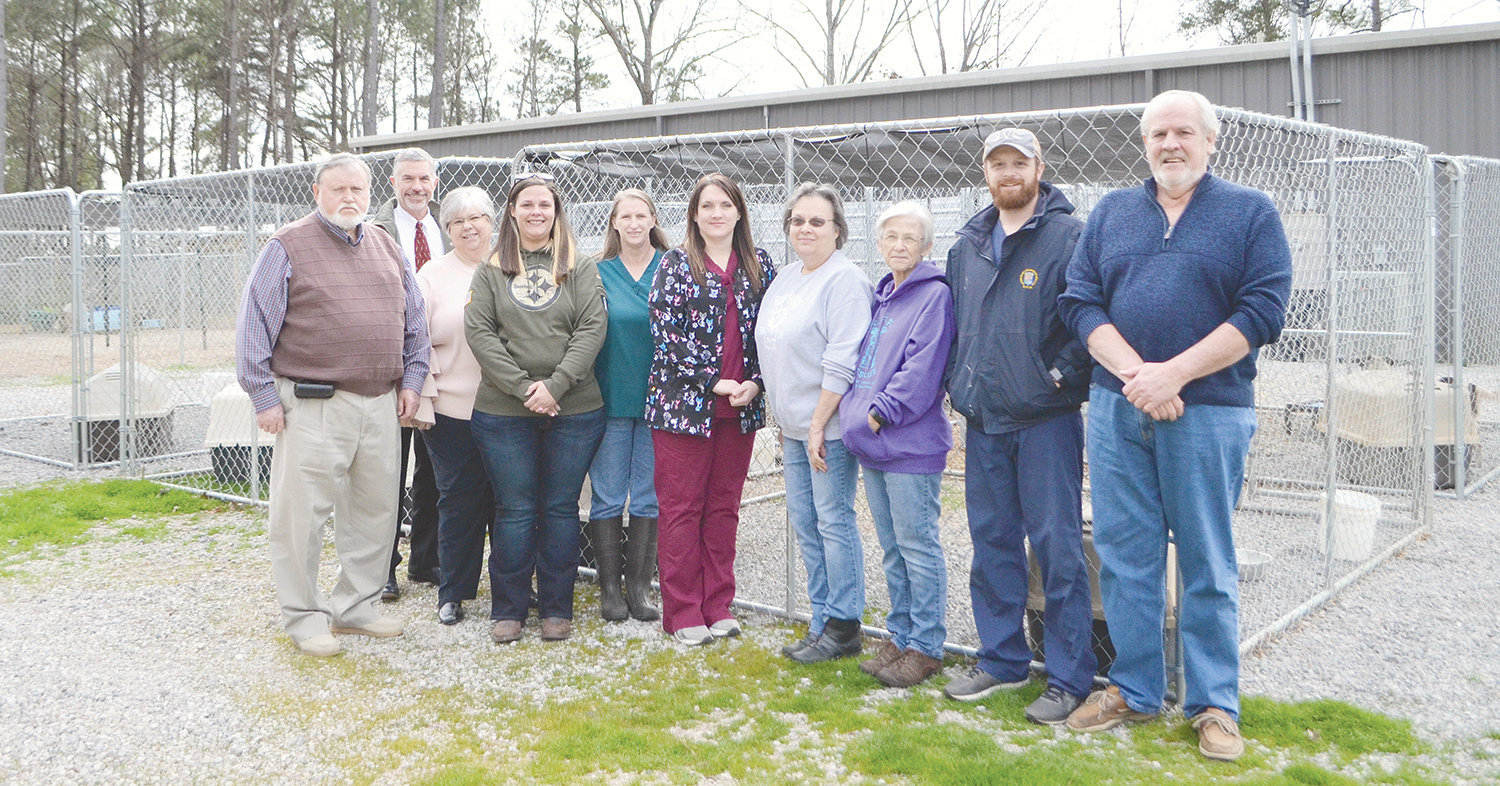 Rescuers United for Furbabies and Walker County Commission representatives, along with Walker County Humane and Adoption Center workers, are seen at the animal shelter when it reopened Tuesday.