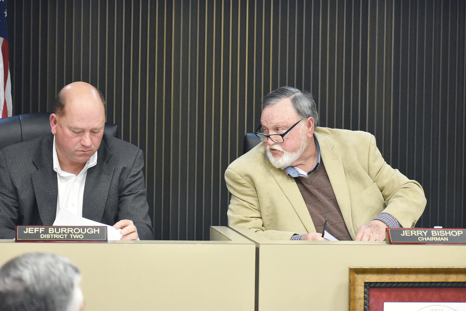 Walker County Commission Chairman Jerry Bishop, right, has an aside comment with District 2 Commissioner Jeff Burrough Tuesday night during discussion about approving repair work for the county jail.