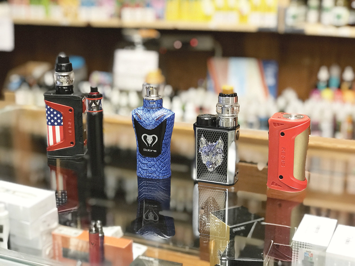These are examples of mods used for vaping. They contain a battery, a coil and a reservoir for the nicotine juice.