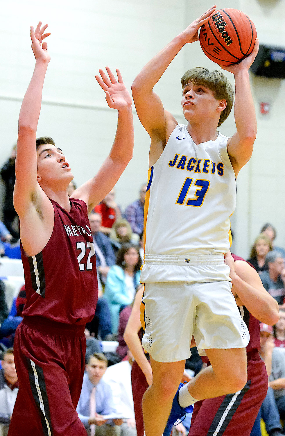 Curry's Jakob Hicks (13) shoots as Haleyville's JT Gilbert (22) defends during their game Thursday night. Haleyville won 49-42 in OT.