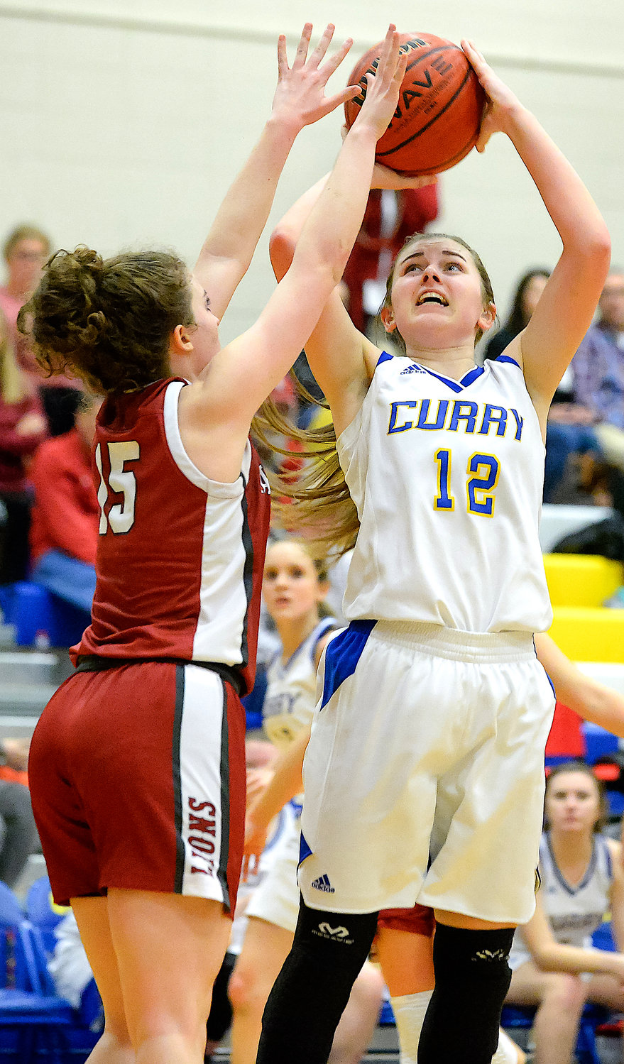 Curry's Morgan Davidson (12) shoots over Haleyville's Alli Temple (15) during the Class 4A, Area 11 Tournament championship game at Curry on Thursday night. Haleyville's girls and boys both won area tournament titles.