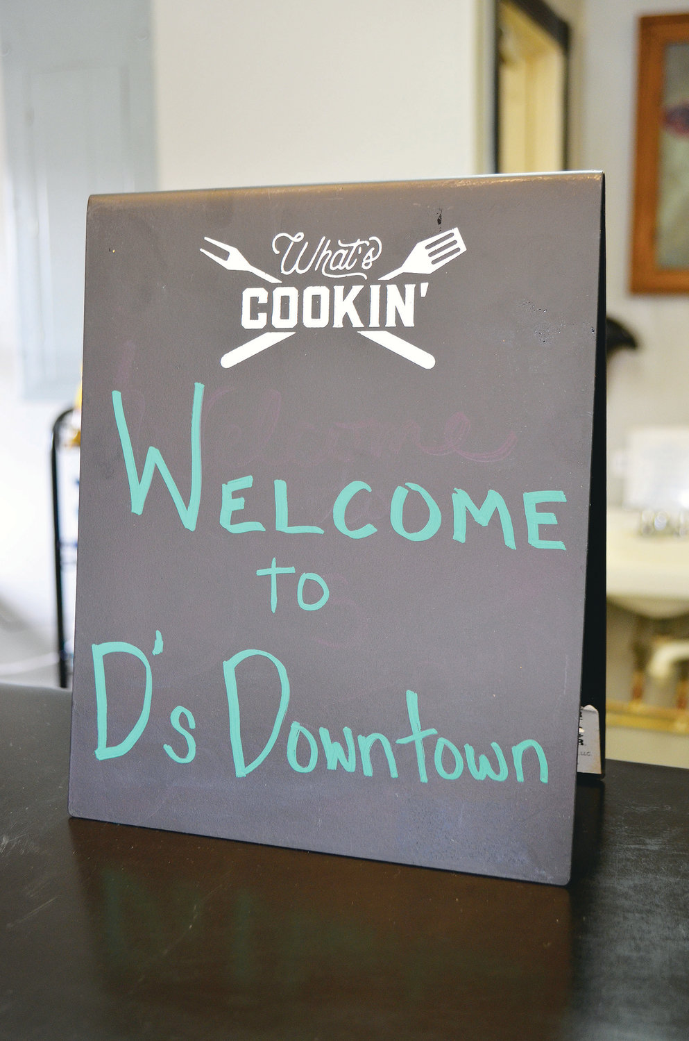 A welcoming sign for D's Downtown Barbecue in Jasper.