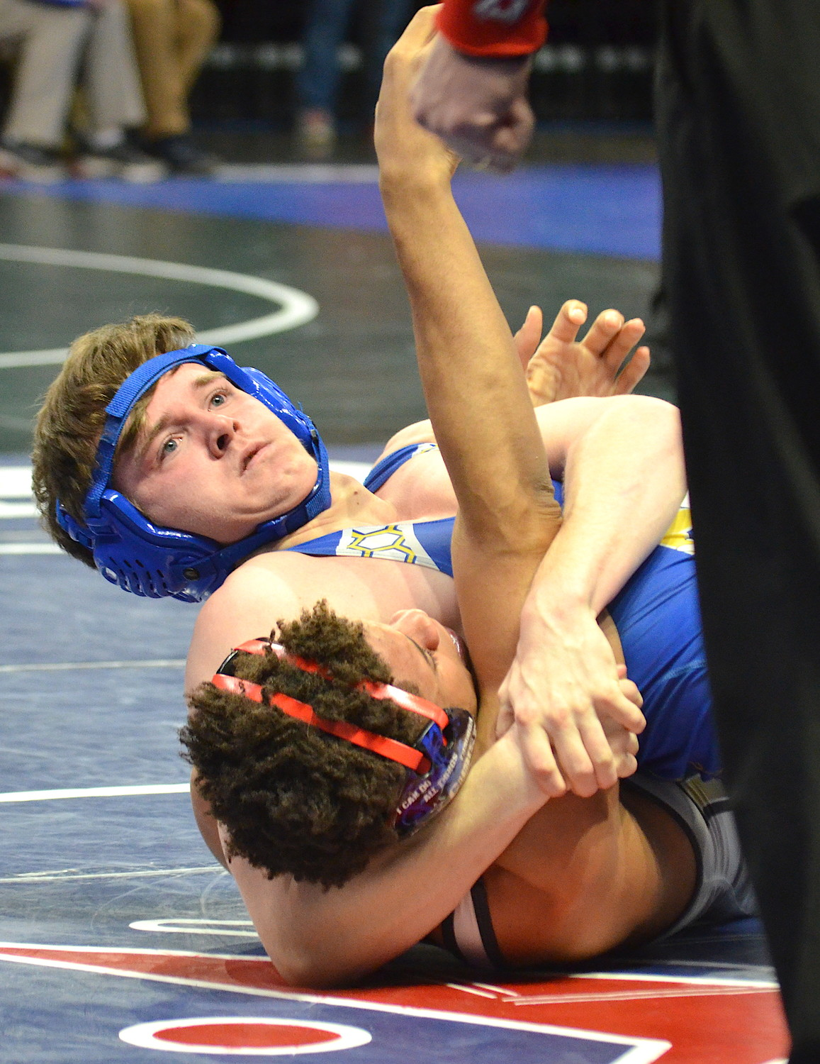 Curry's Nate South, top, battles Jasper's Mark Stitt during their 170-pound match at the North Super Section Tournament in Birmingham on Saturday. South won by pin.