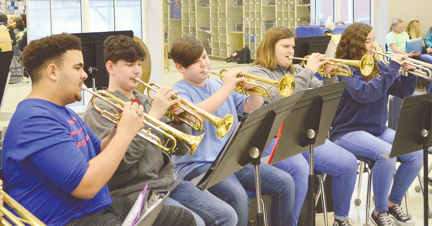 Valley Jr. High School student Rook Robinson, third from left, has band practice Friday at Cordova High School. Valley Jr. High and Bankhead Middle School students are transported to Cordova each day for band opportunities.