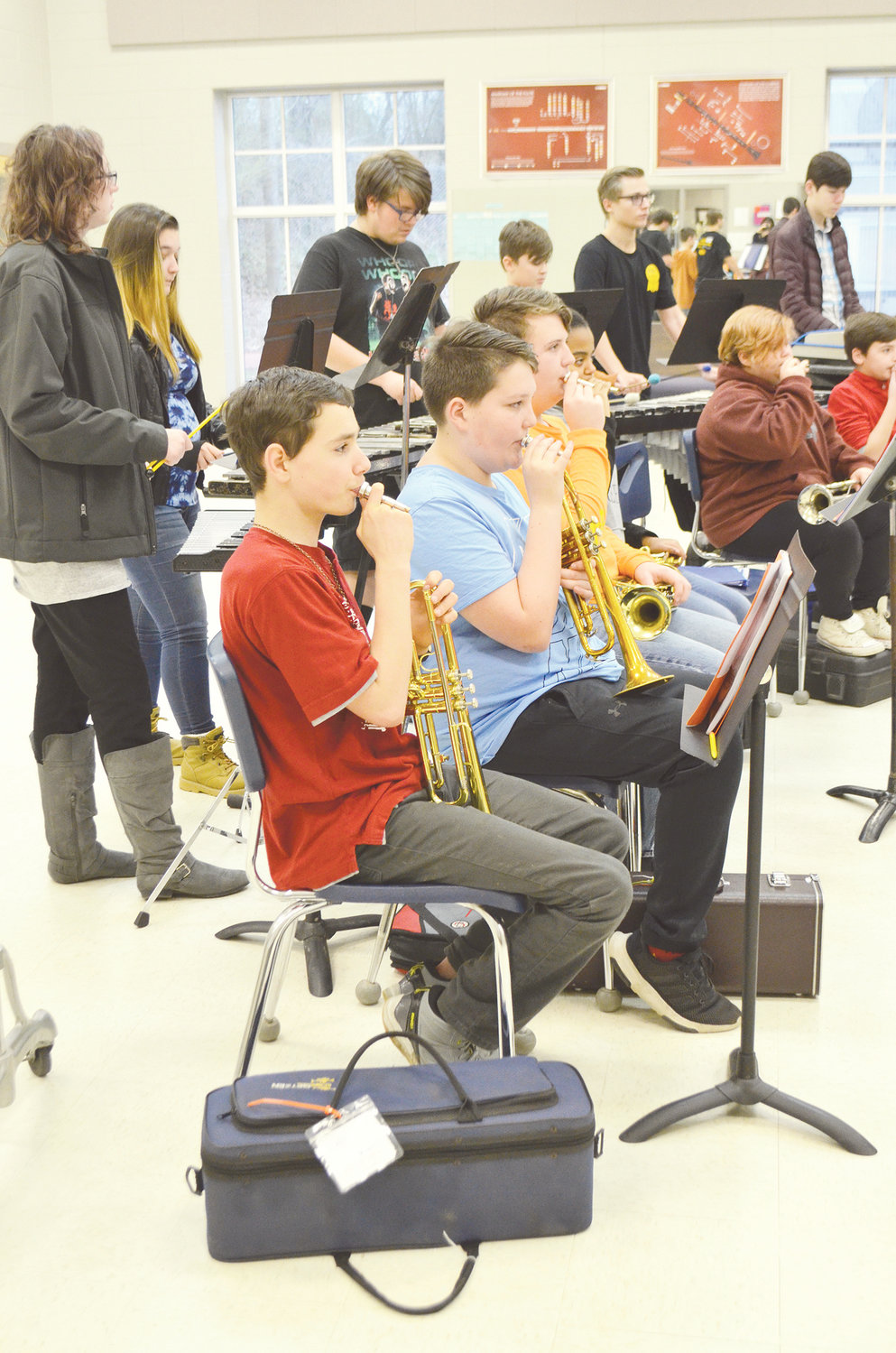 Students from Valley Jr. High and Bankhead Middle School are transported to Cordova High School each day for band practice. Students in Grades 7-12 are shown practicing Friday.