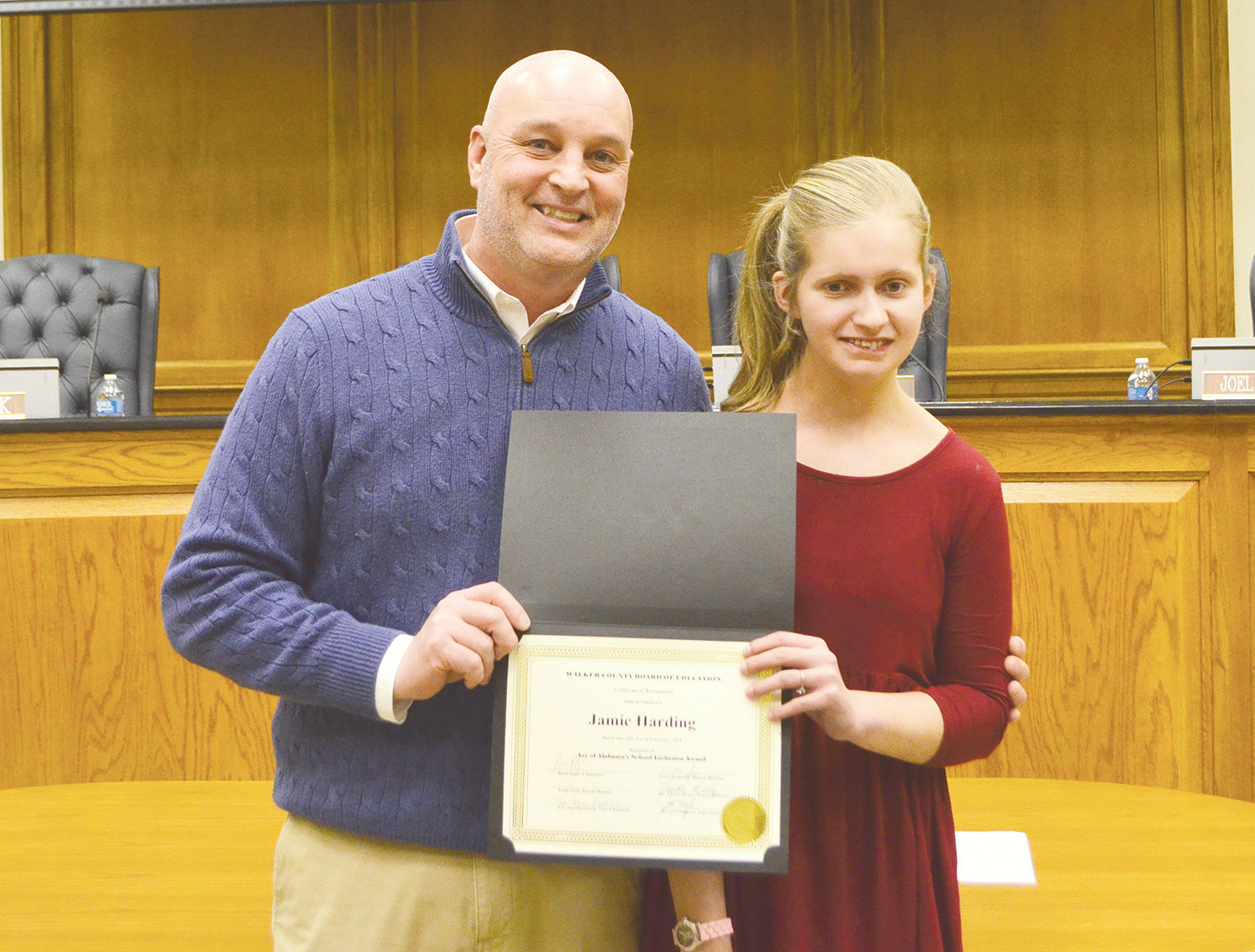 Pictured is Curry Middle School Coach Jamie Harding with London Farris. He was recently honored for encouraging Farris to join the school's volleyball team.