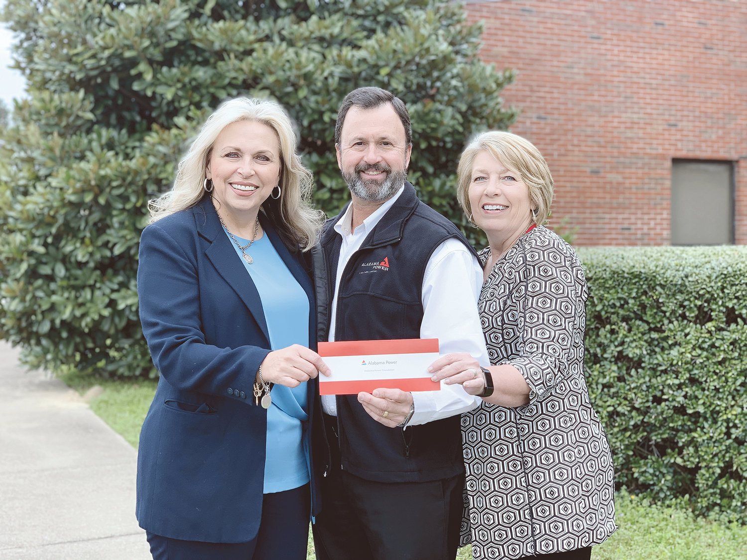From left to right, Dr. Kim Ennis (President of Bevill State Community College), Billy Doss (Business Office Manager for Alabama Power), and Jana Kennedy (Director of Student Services for Bevill State Community College Sumiton Campus) receive a Good Roots grant for the Sumiton campus.