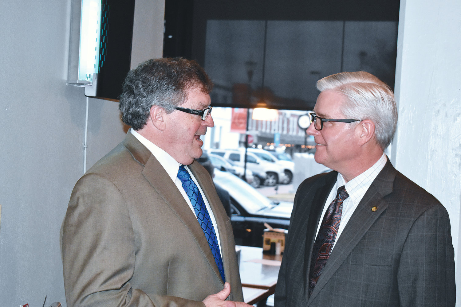 State Rep. Tim Wadsworth, R-Arley, left, and Senate Majority Leader Greg Reed, R-Jasper, share a moment at a Jasper Main Street reception on Tuesday.