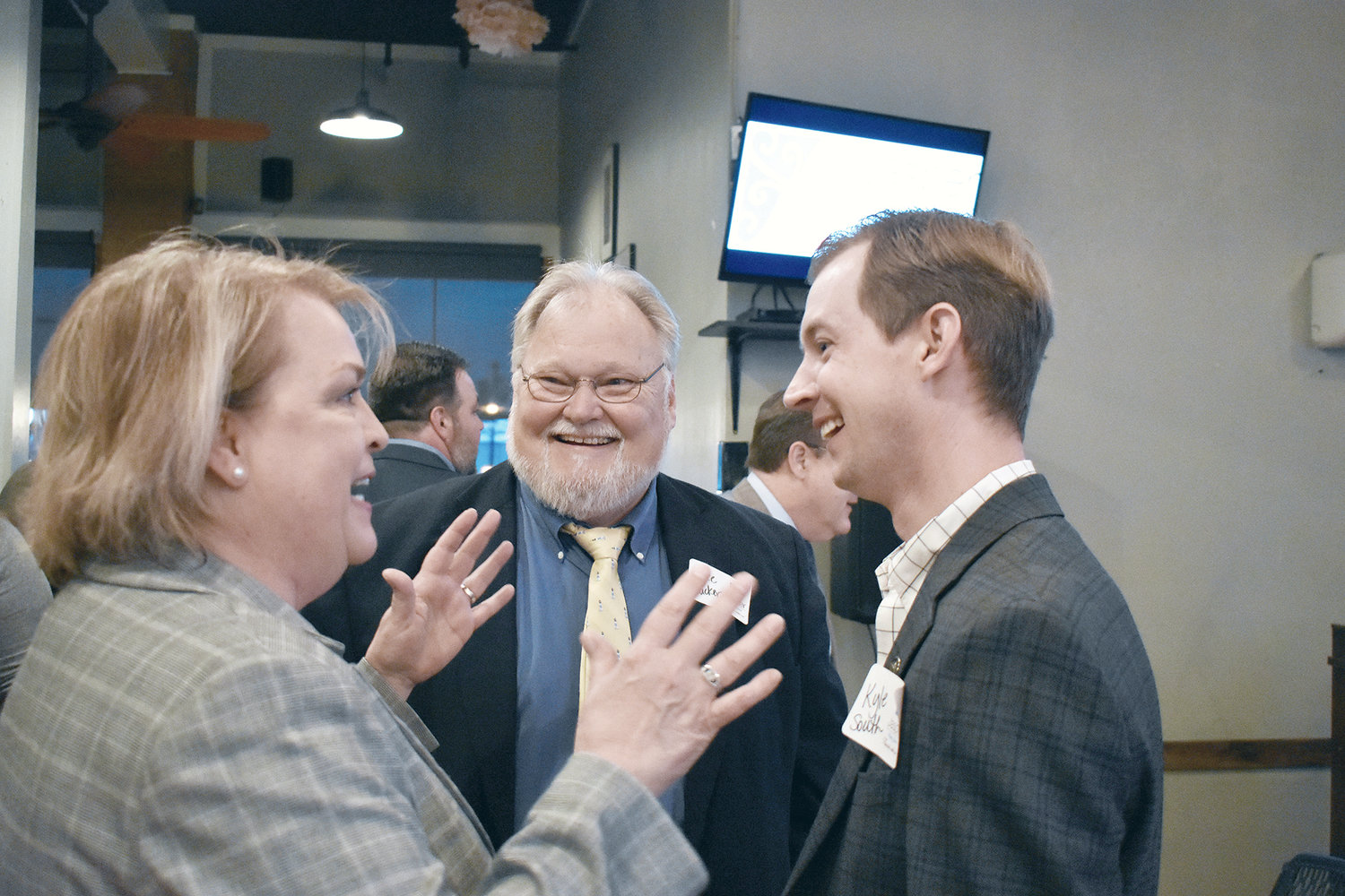 State Rep. Connie Rowe, R-Jasper, left, Walker County Probate Judge Lee Tucker, center, and state Rep. Kyle South, R-Fayette, share a laugh during a Jasper Main Street reception on Tuesday.