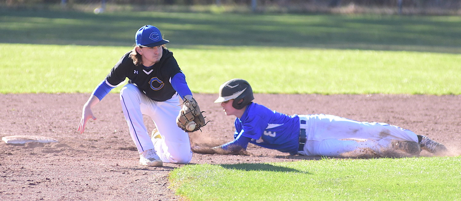 Carbon Hill's Caleb Kilgore steals second base as Curry's Luke Smith comes up with the throw.
