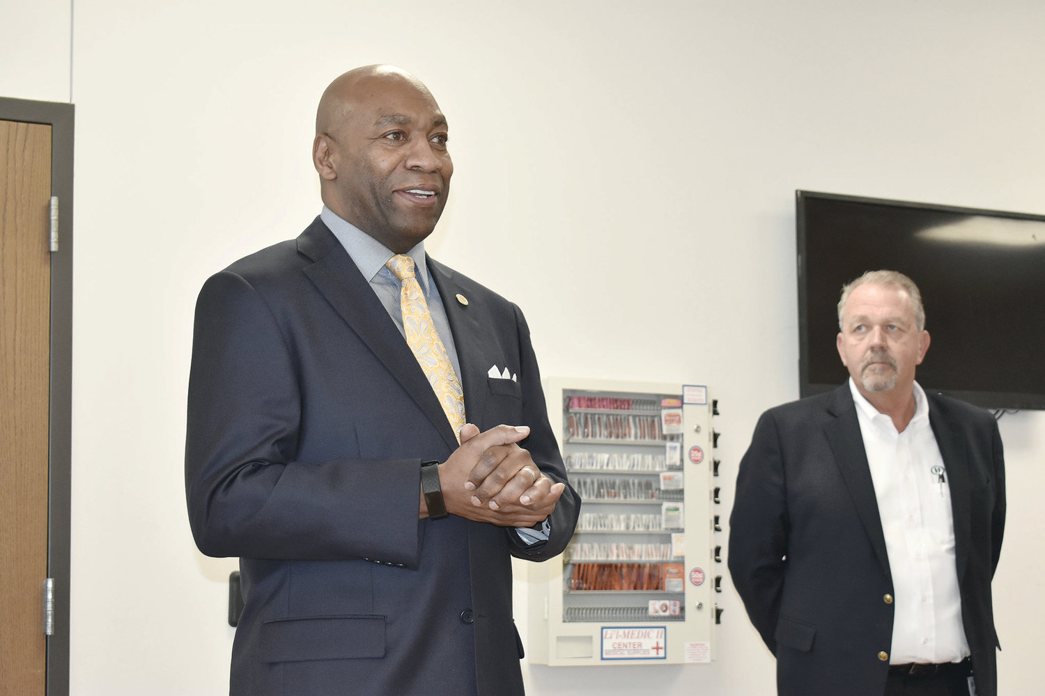 Alabama Labor Secretary Fitzgerald Washington speaks to HTNA employees at a safety award ceremony at the Jasper plant Wednesday. Steven Robbins, vice president of human resources and general affairs, listens nearby.