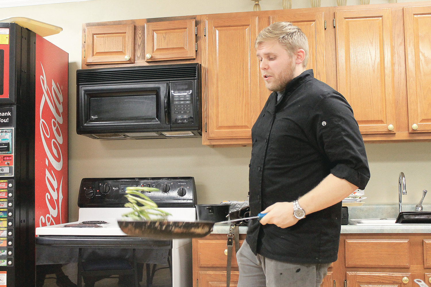 Chef Jonathan Fagan flips asparagus during a cooking demonstration at HarborChase of Jasper last month.