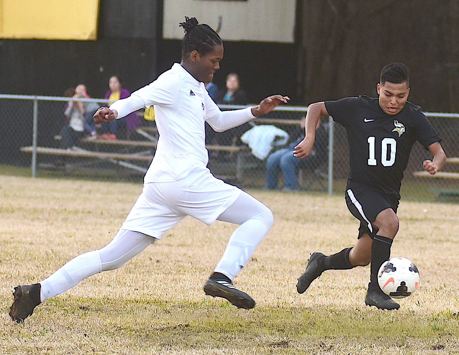 Jasper's Domingo Jose 'Larios (10) escapes a Ramsay defender during their area soccer team on Monday night at the Jasper toy bowl field. The Vikings moved to 2-0 in area play with a 7-1 victory.