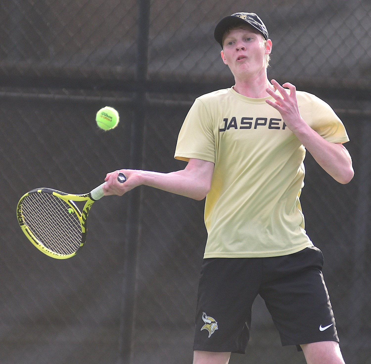 Mason Woodman hits a forehand in his No. 1 singles match against Indian Springs