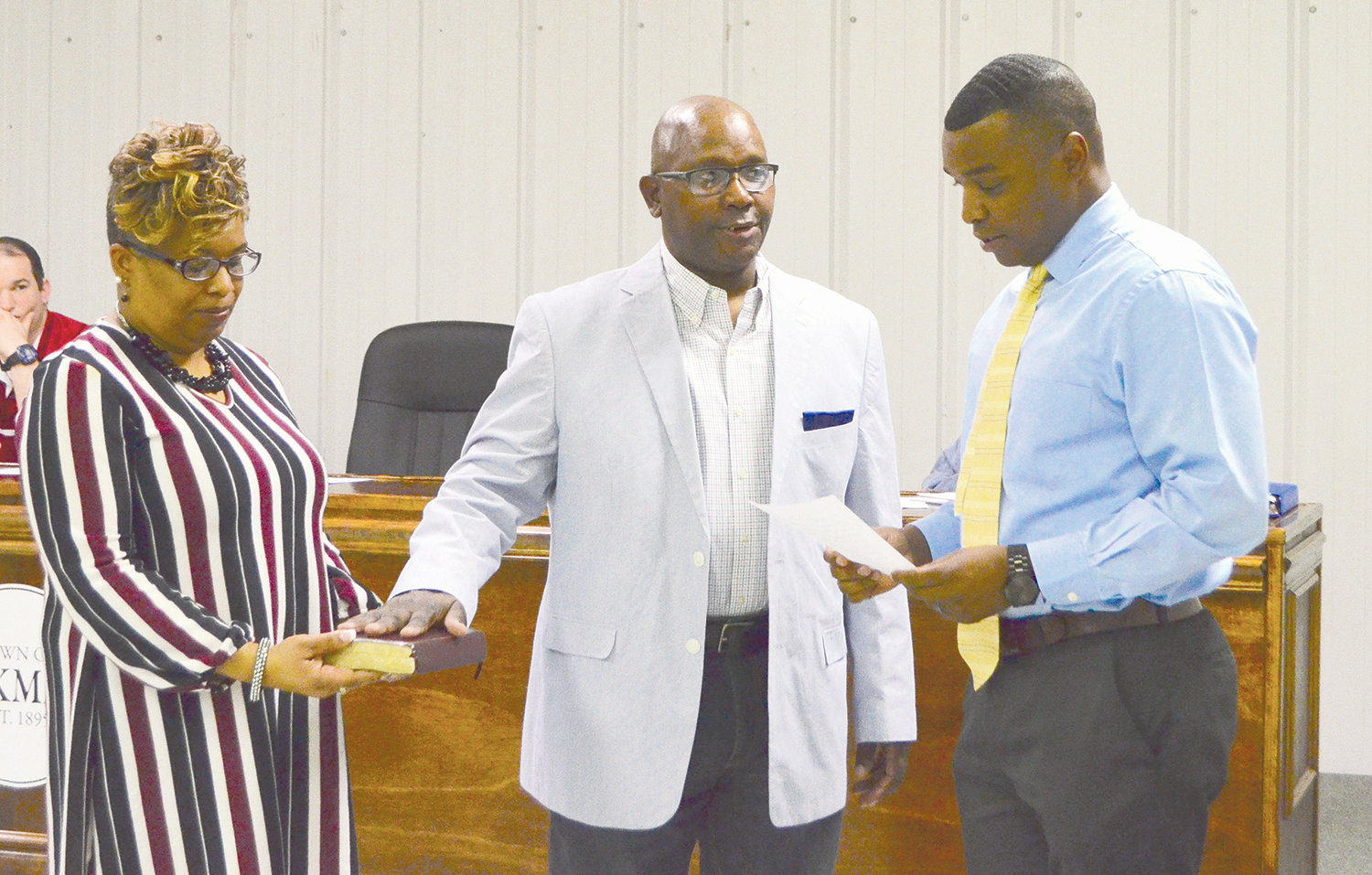 Rodney Harris, at center, stands alongside his wife as he is sworn in as the newest member of the Oakman Town Council by Mayor Cory Franks.