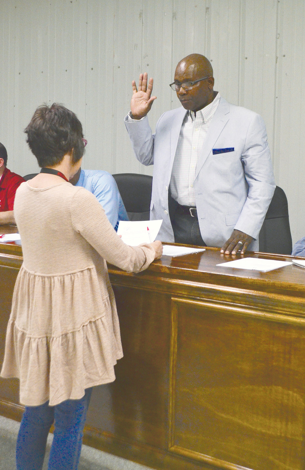 Rodney Harris, Oakman's new council member, is sworn in for a second time by Town Clerk Lisa Lockhart Monday.