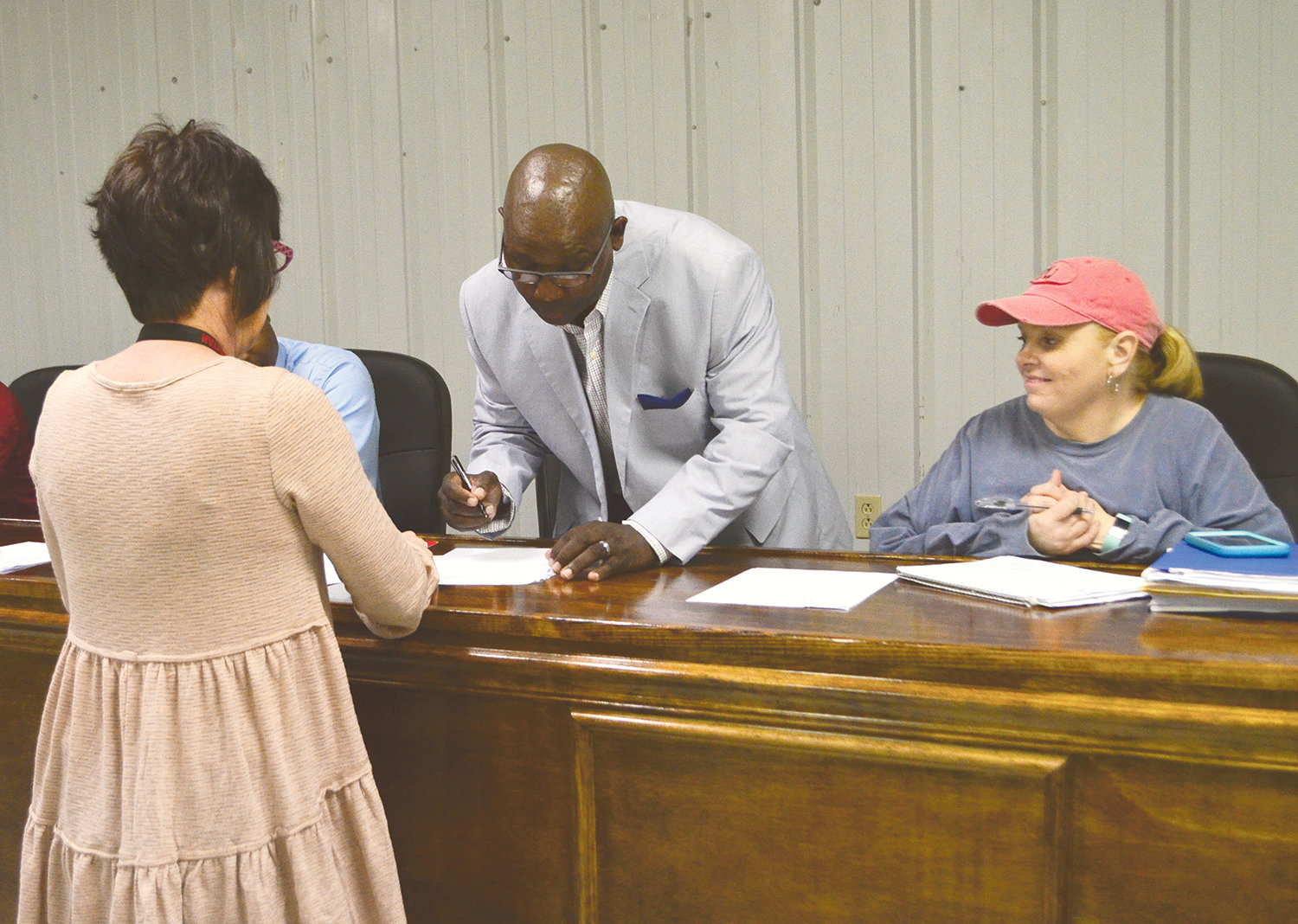 Rodney Harris signs notarized documentation Monday after his appointment to the Oakman Town Council.