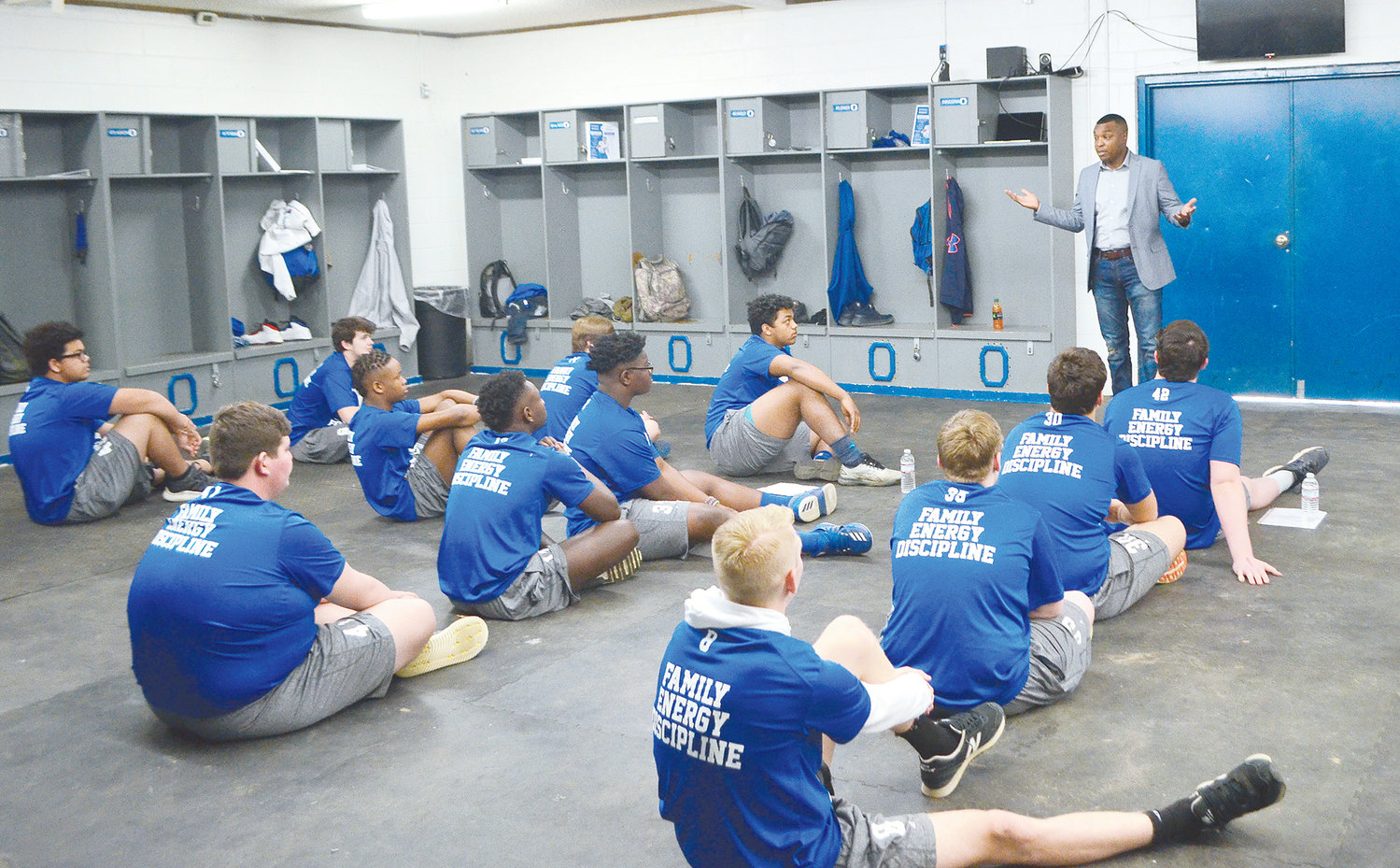 Oakman Mayor Cory Franks speaks to football players at Oakman High School Thursday.