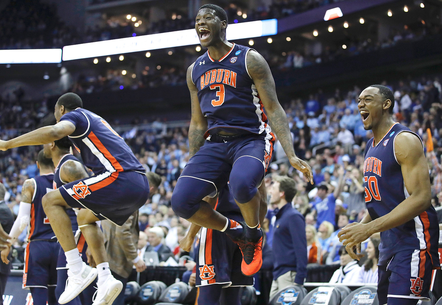 Auburn's Danjel Purifoy (3) and Austin Wiley (50) celebrate near the end of a men's NCAA tournament college basketball Midwest Regional semifinal game against North Carolina Friday in Kansas City, Mo. (