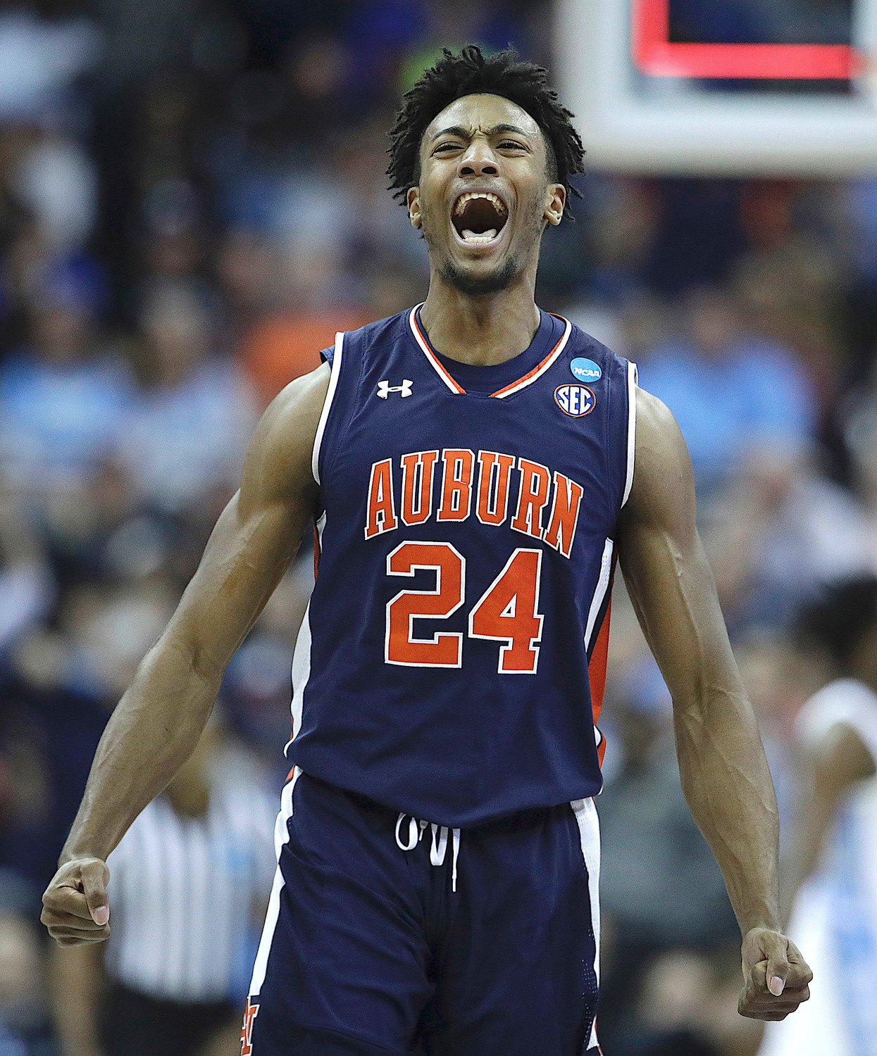 Auburn's Anfernee McLemore celebrates during the men's NCAA tournament college basketball Midwest Regional semifinal game against North Carolina Friday in Kansas City, Mo. Auburn won 97-80.