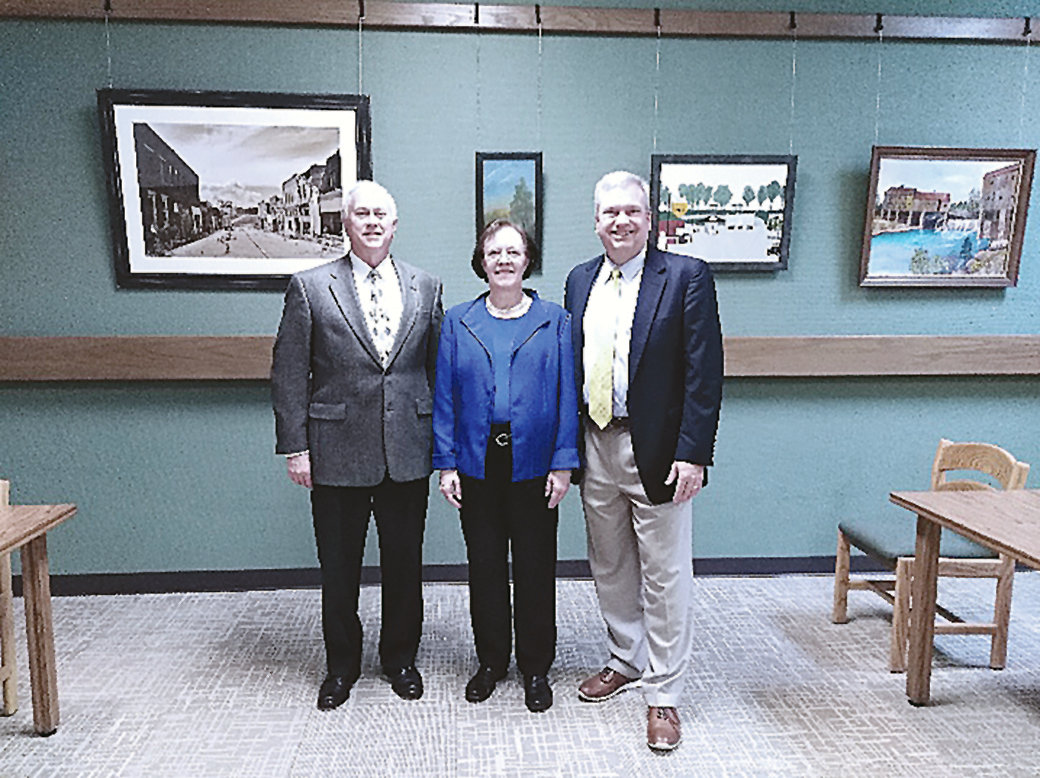 Club president Greg Williams, librarian Sandra Underwood and club member Fred May posed Tuesday for a photo in the room.