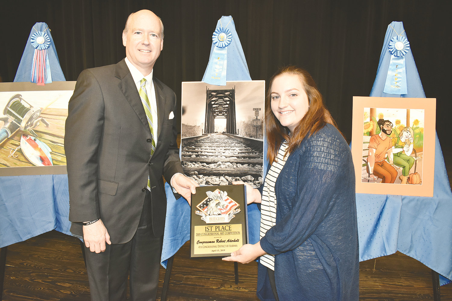 U.S. Rep. Robert Aderholt hosted his District 4 Congressional Art Competition Monday at Jasper High School, where an awards ceremony held at the high school auditorium. The event, which rotates around the district, honored student artists from across the 4th Congressional District. Ivy Trotter, a junior at Jasper High School, won first place in the Photographs Division, using a photograph she took in Cordova at the railroad trestle in November 2017.