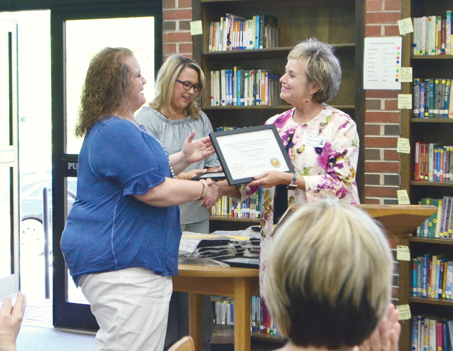 Tracey Dockins of T.R. Simmons Elementary School was honored for 14 and a half years of service in the CNP program.