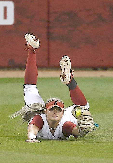 Alabama outfielder Kendall Beth Sides makes a diving catch against Georgia earlier this month. The grab made ESPN's Top 10 plays. The former Sumiton Christian star is hitting .298 on the season for the Tide.
