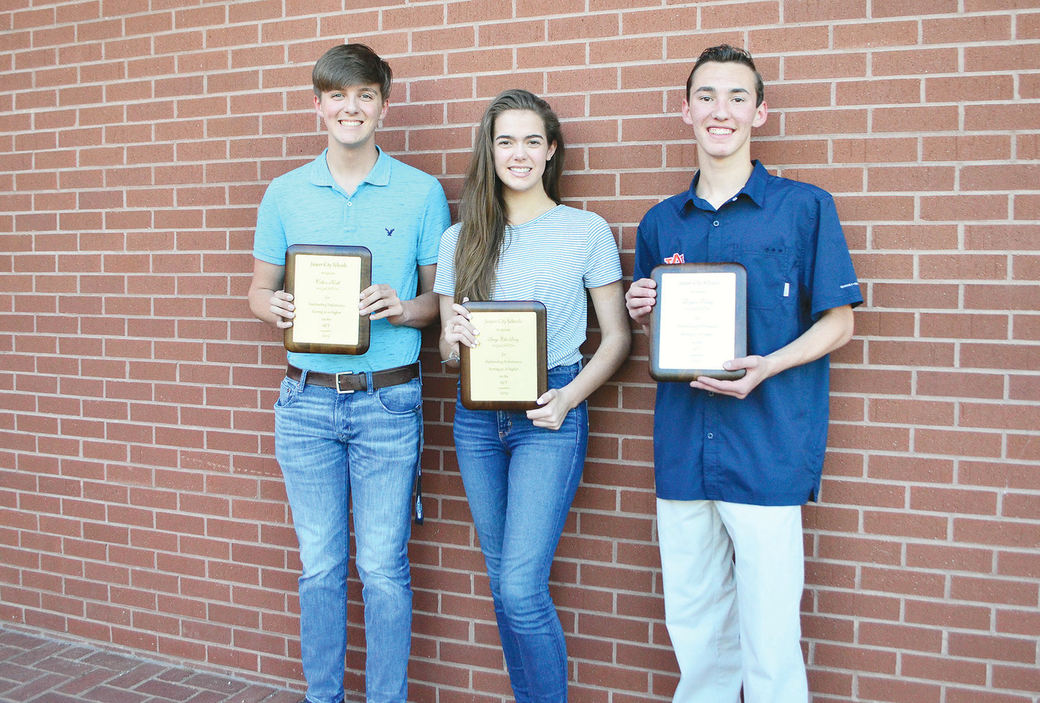 Three Jasper High School students were named part of the school's ACT 30+ Club at the Jasper City Board of Education meeting Monday. From left to right, Colton Hall, Ivey-Elise Ivey and Dayton Talley have all earned a 30 or higher on the ACT. The highest score a student can receive is a 36. High ACT scores can help students earn full ride scholarships to colleges and universities. Over 20 Jasper High students have earned ACT scores of 30 or greater.