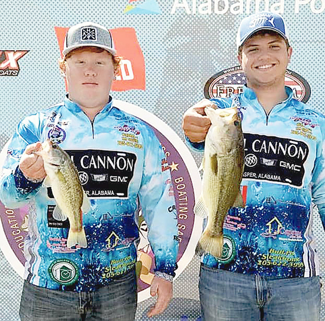 Nick Brubaker and Nathan Wright show catches at a tournament last year. They are both members of the Oakman High School fishing team.