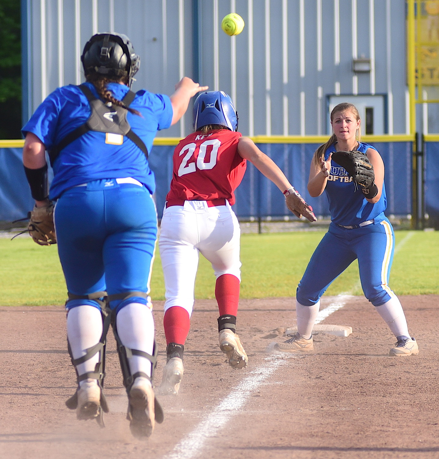 Curry players catch a Cordova baserunner in a rundown during Tuesday's game.